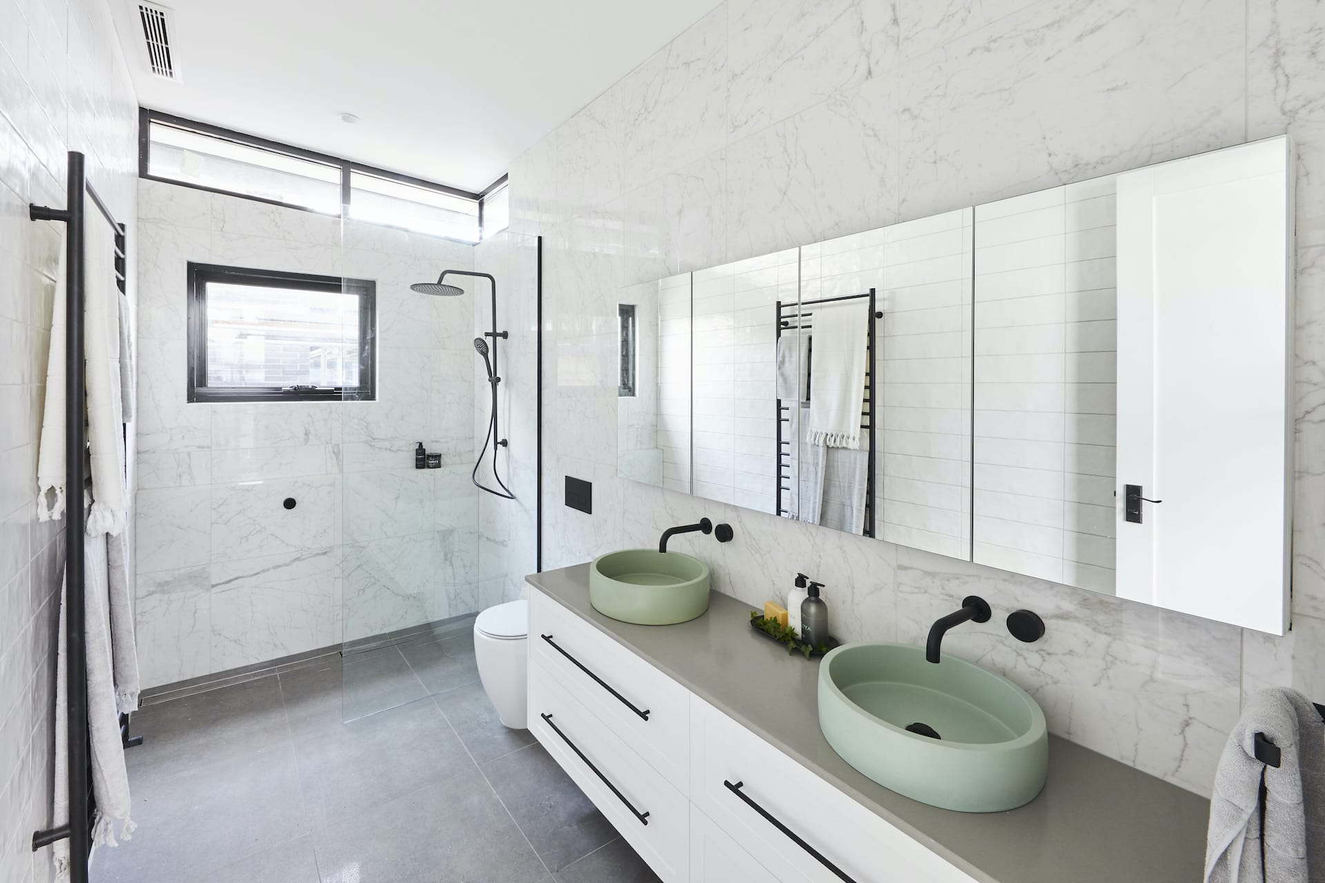 the block 2020 daniel and jade upstairs bathroom with white marble gloss tiles and shaker vanity black handles
