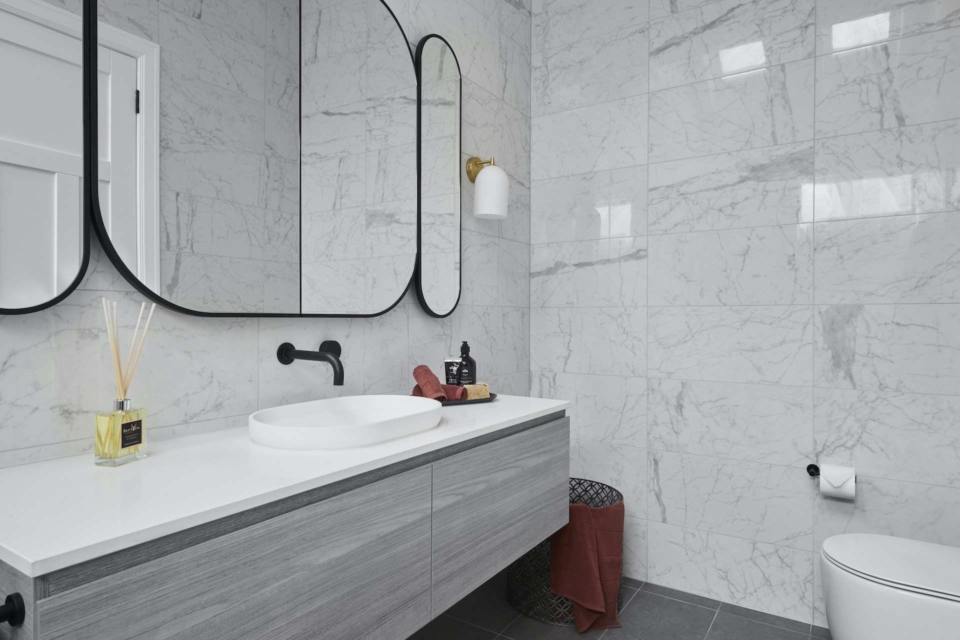 the block 2020 guest ensuites daniel and jade modern luxe white marble bathroom tiles with black accents