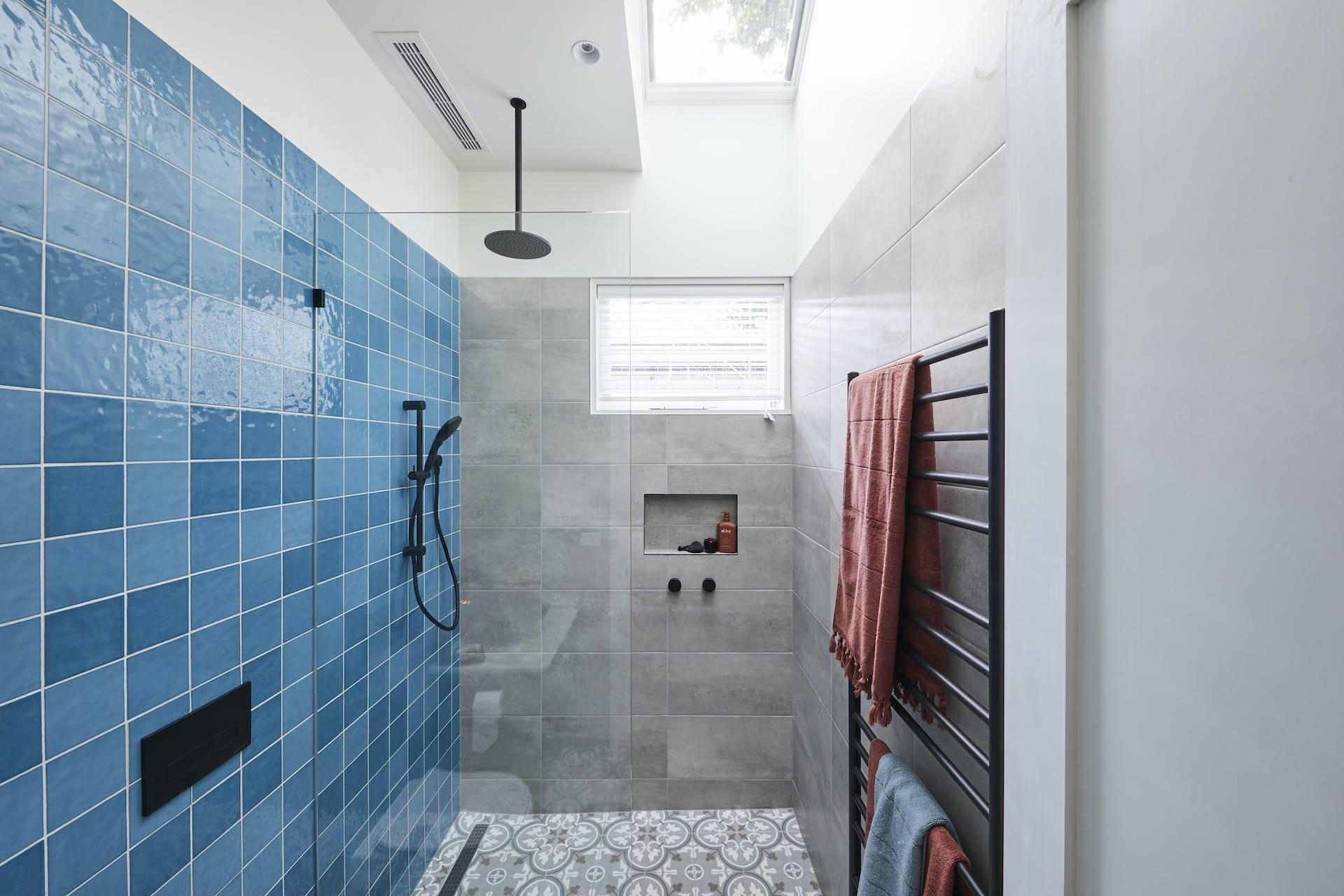 the block 2020 guest ensuites harry and tash blue bathroom tiles