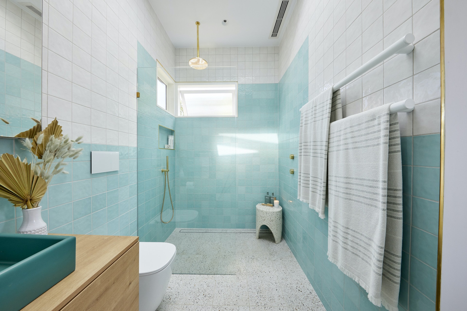 the block 2020 guest ensuites jimmy and tam bathroom with turquoise tiles