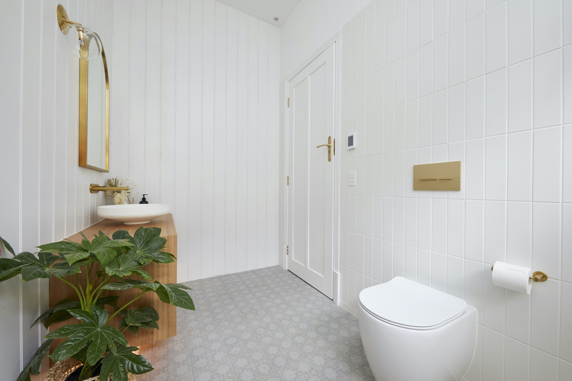 the block 2020 guest ensuites luke and jasmin white bathroom with gold accents