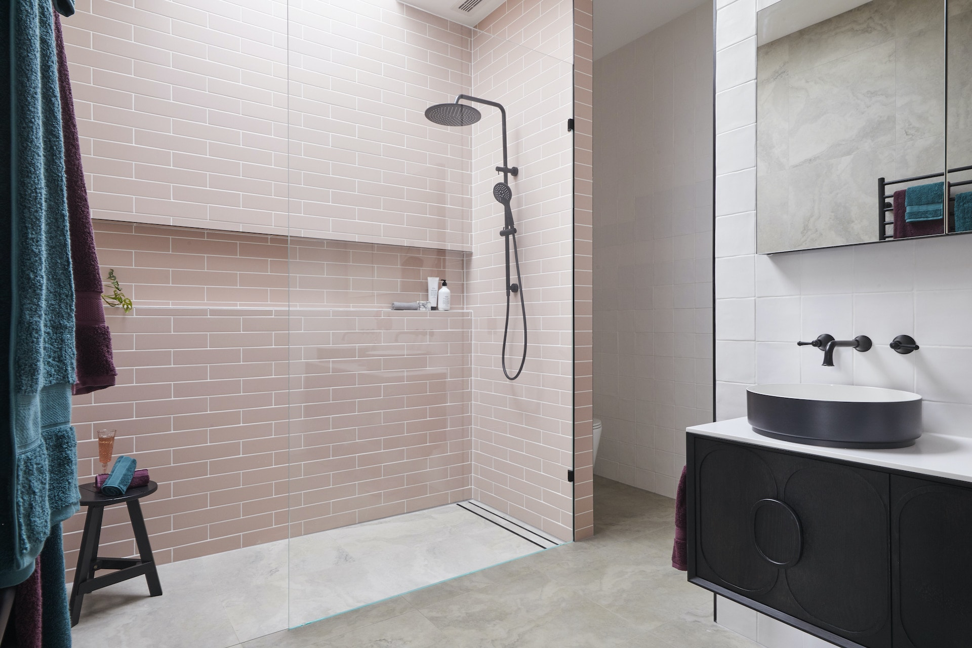 the block 2020 guest ensuites sarah and george bathroom with pink tiles in shower