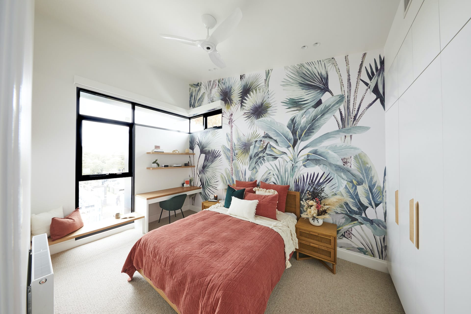 the block 2020 harry and tash upstairs bedroom with tropical feature wallpaper and coral bedding