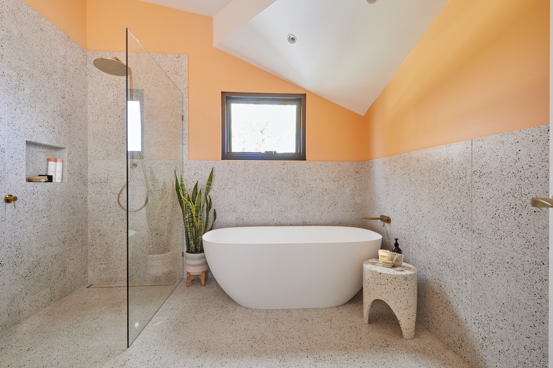 the block 2020 jimmy and tam upstairs bathroom with peach coloured wall and grey tiles