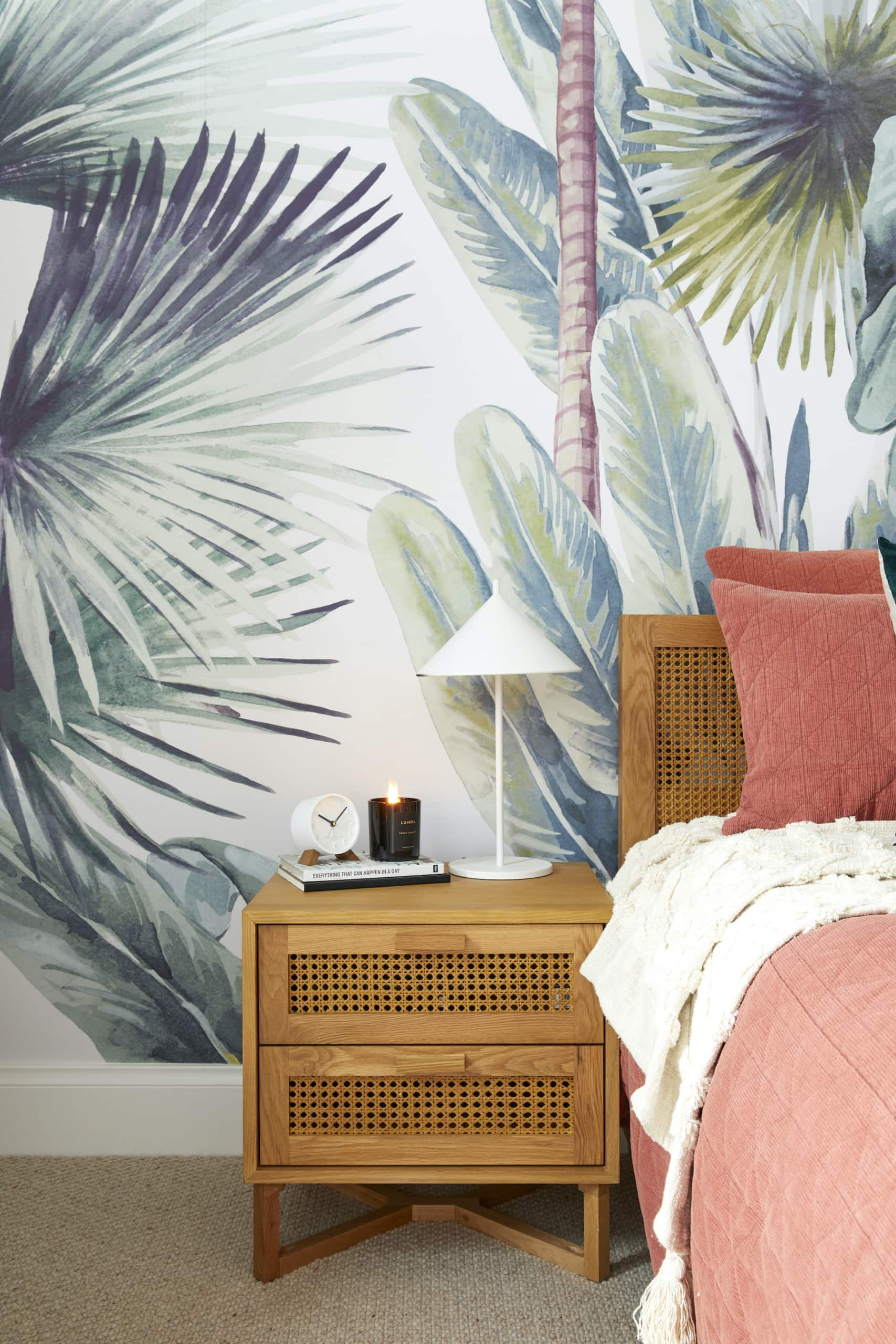 the block 2020 jimmy and tam upstairs bedroom with tropical wallpaper and timber bedside table
