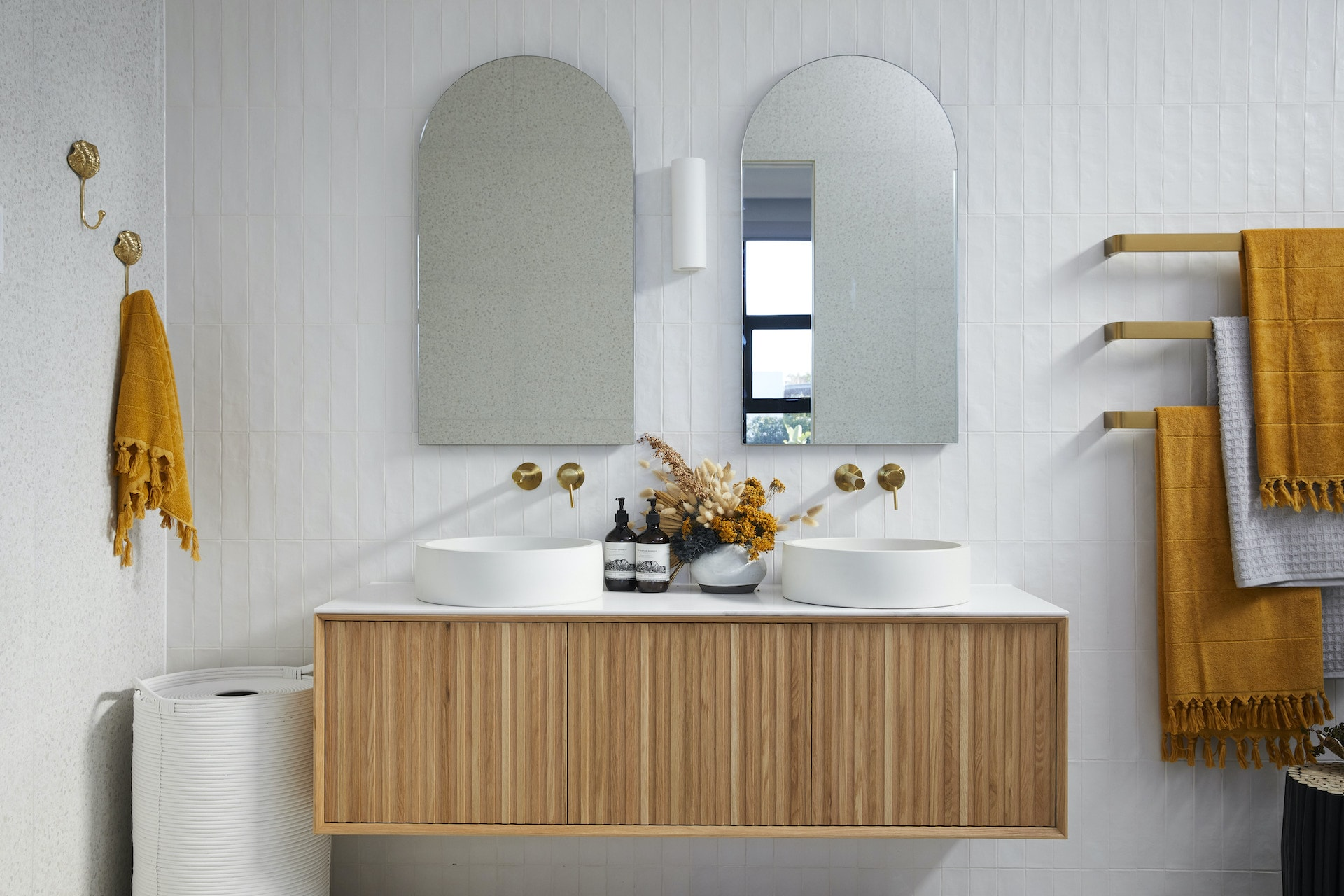 the block 2020 luke and jasmin modern bathroom with arched mirrors and slatted timber floating vanity