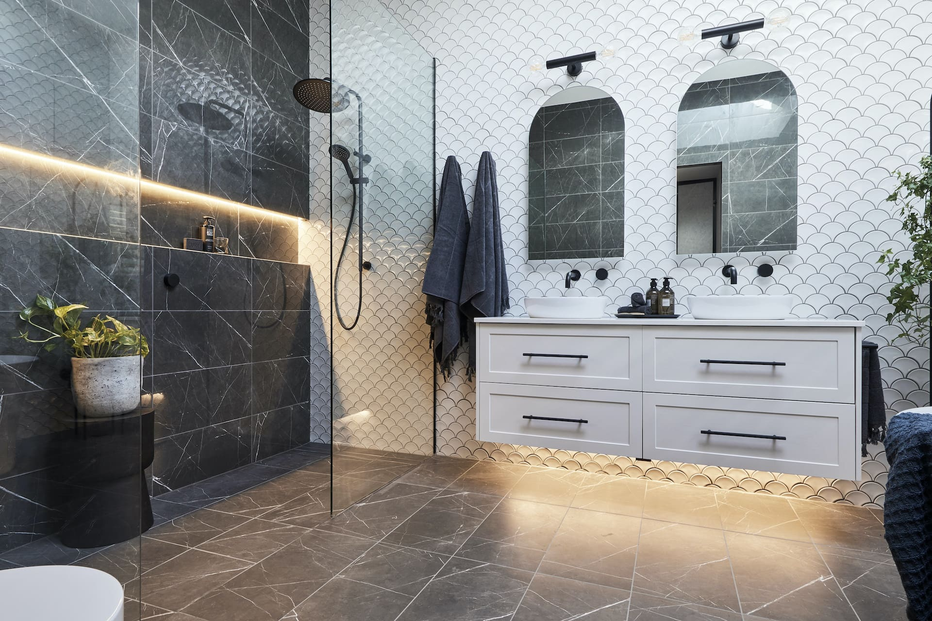 the block 2020 master ensuite floating vanity and arched mirrors