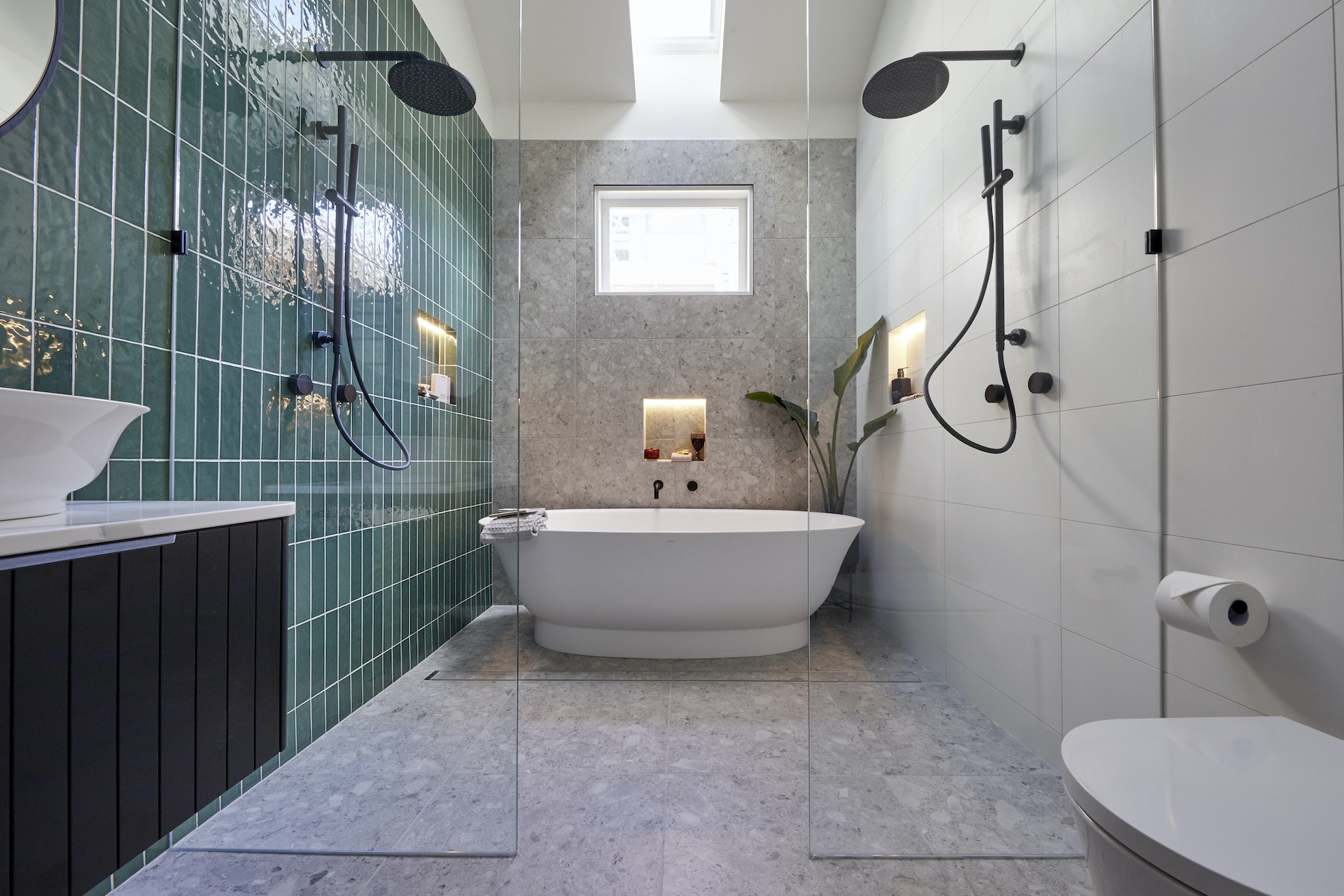 the block 2020 master ensuite harry and tash green tile bathroom with grey floor tiles