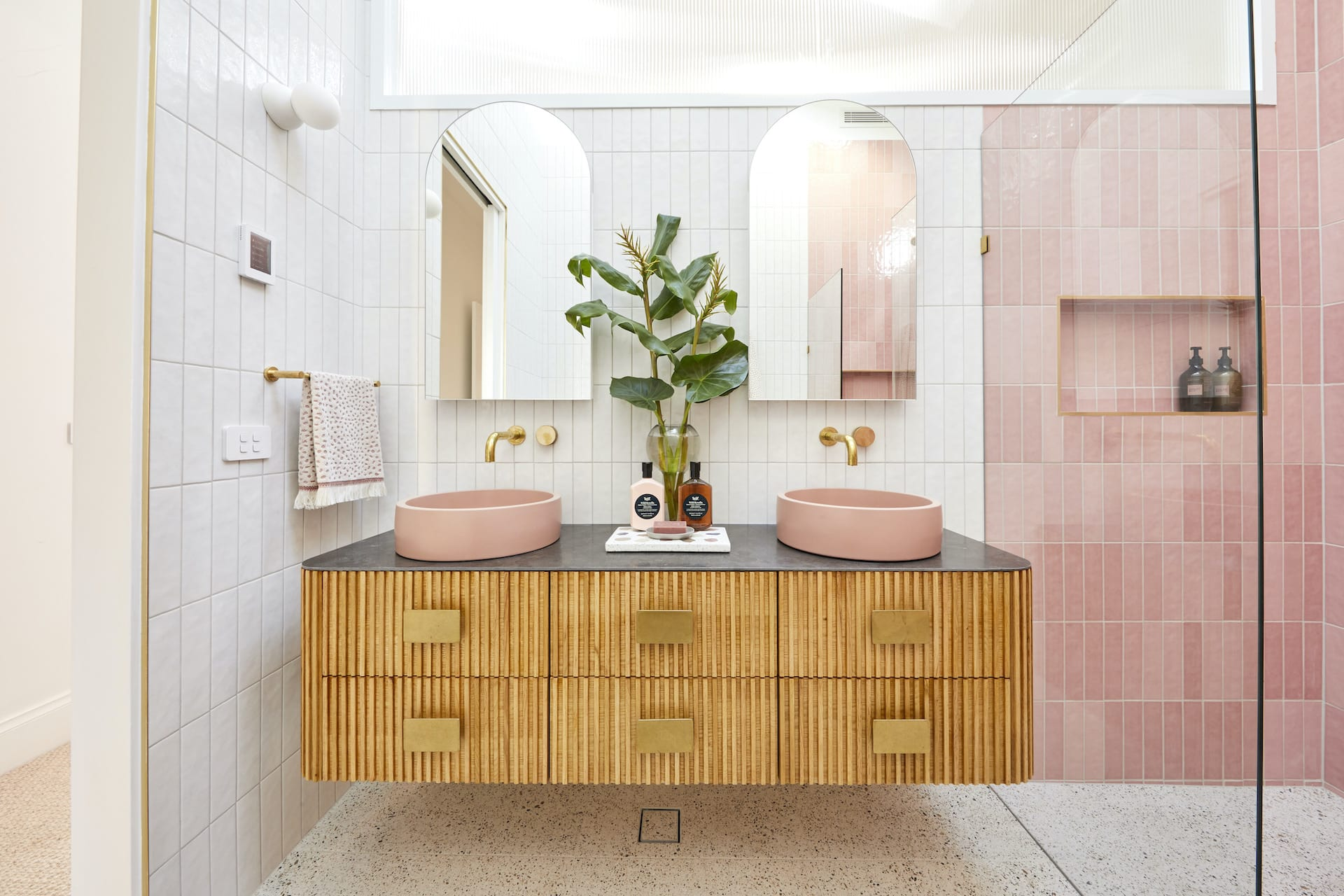 the block 2020 master ensuite jimmy and tam pink bathroom tiles and floating timber vanity