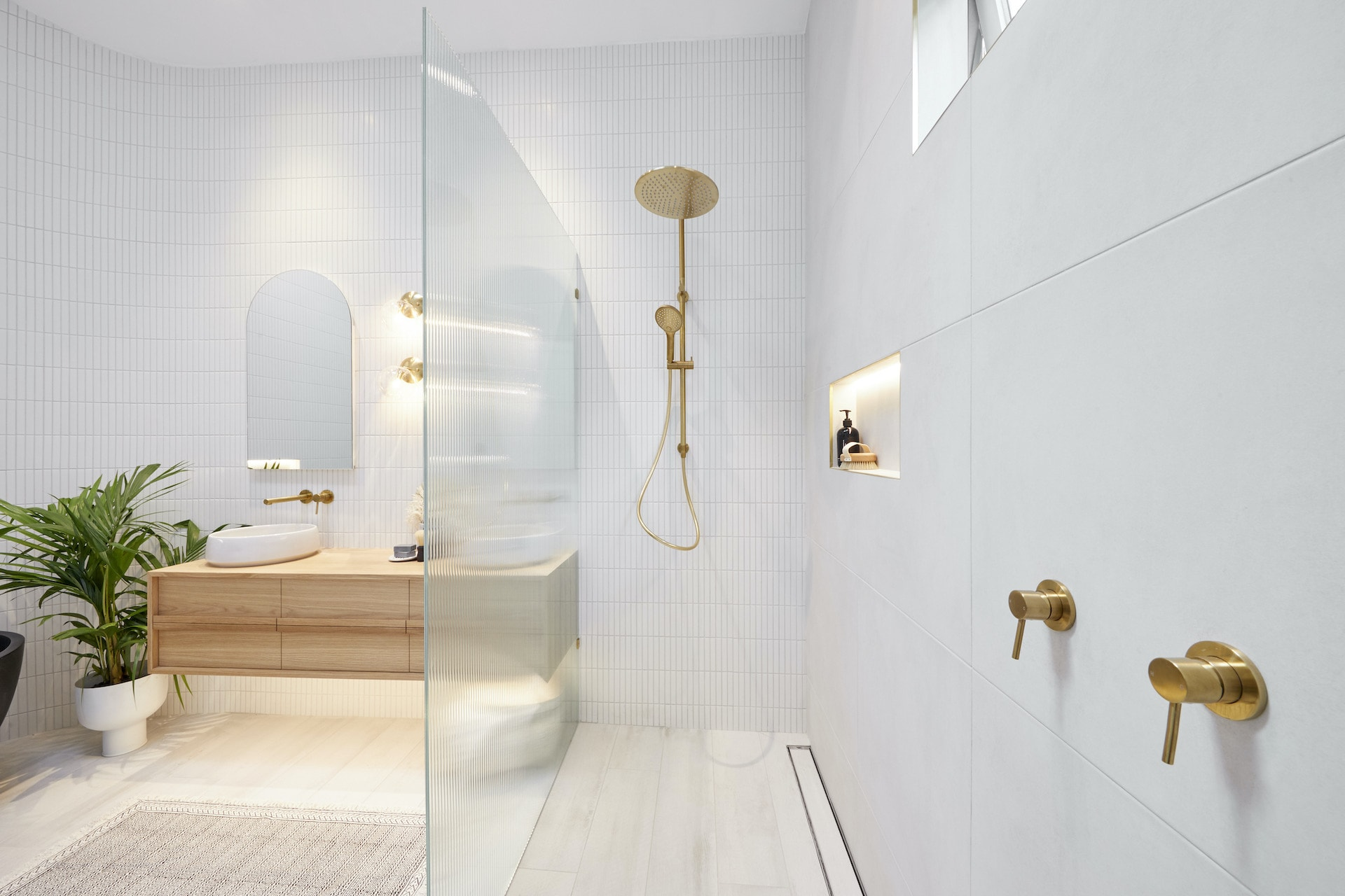 the block 2020 master ensuite luke and jasmine brass bathroom taps with white tiles