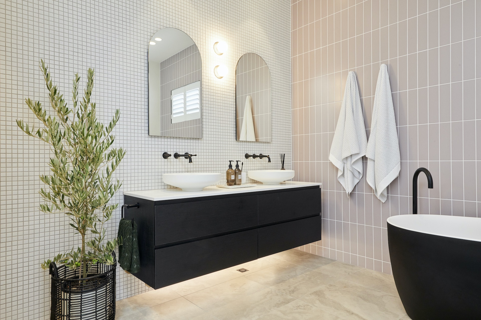 the block 2020 master ensuite sarah and george bathroom with pink wall tiles and black vanity