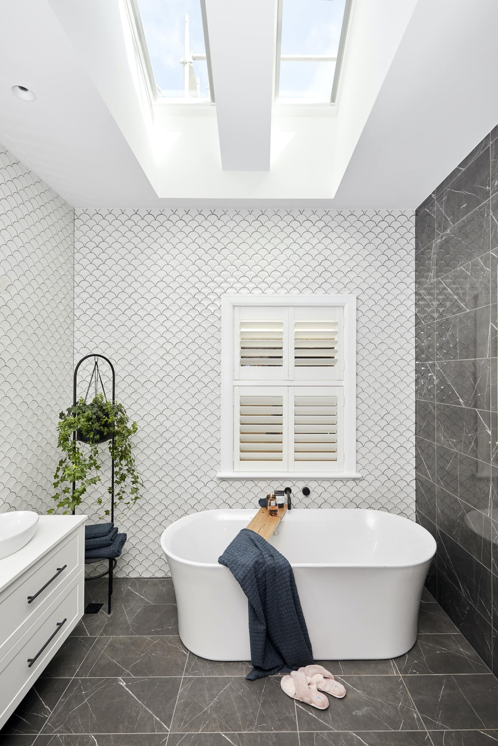 the block 2020 master ensuite white bath and fish tiles