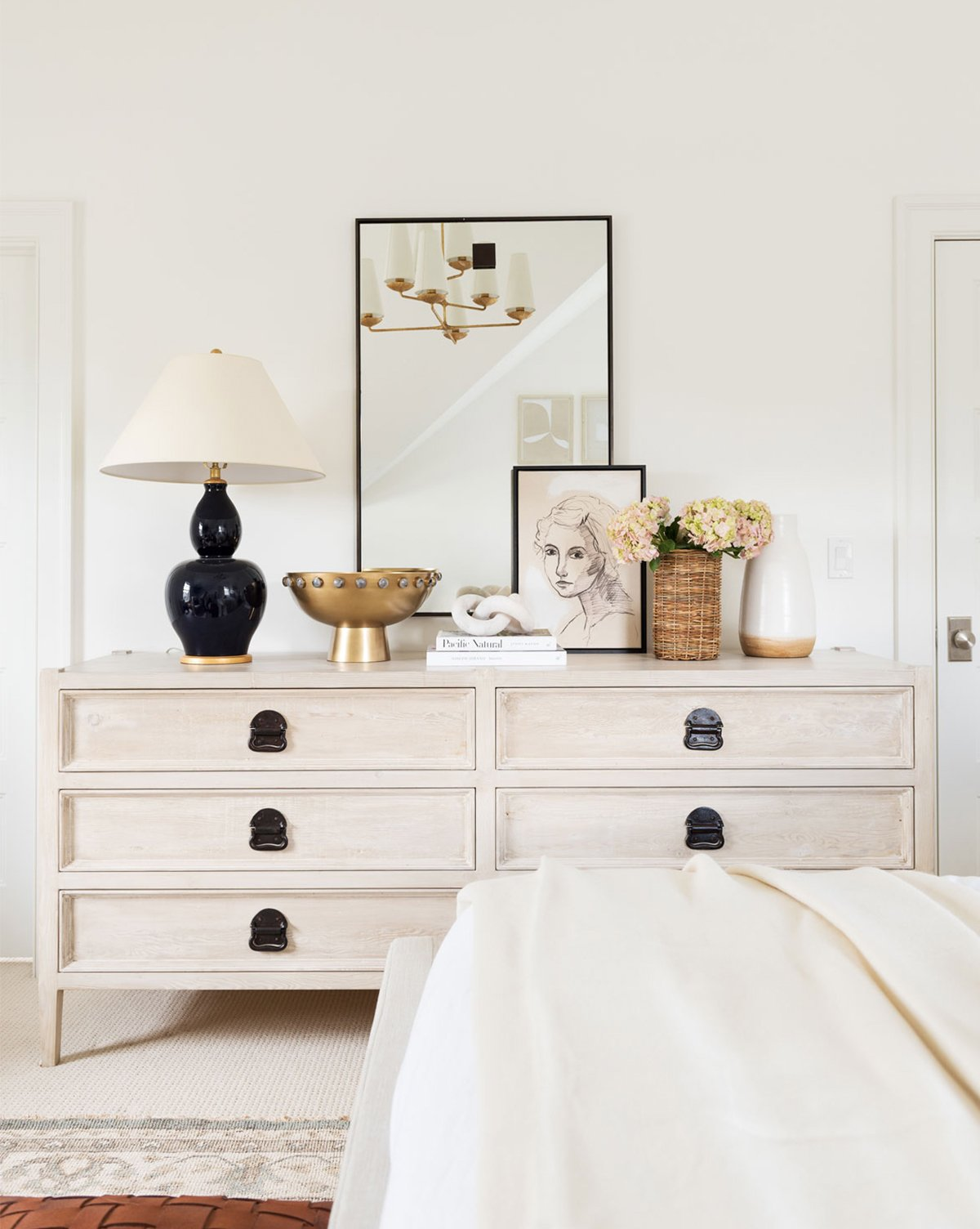 vintage white chest of drawers in bedroom with vintage brass styling