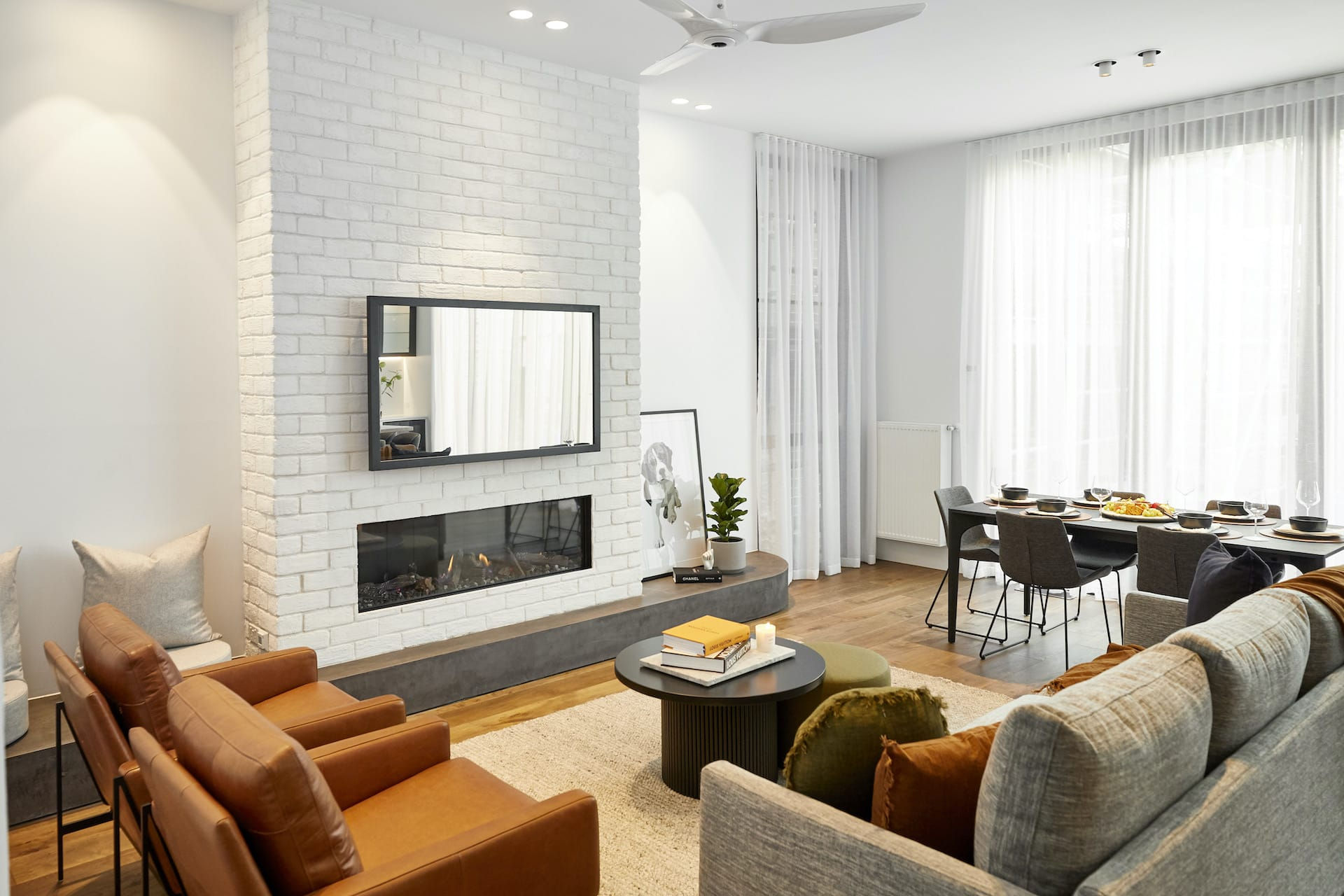 The Block 2020 Sarah and George living and dining room with tan leather armchairs