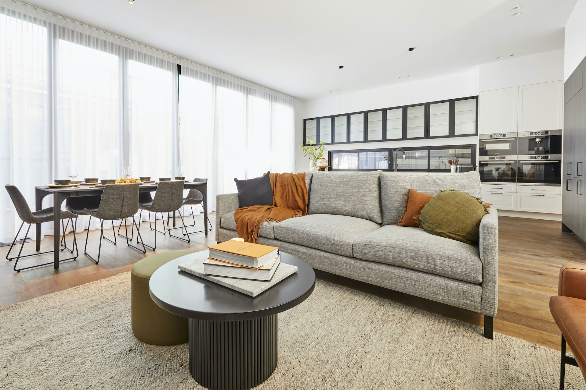 The Block 2020 Sarah and George living room with grey sofa round coffee table with round ottoman