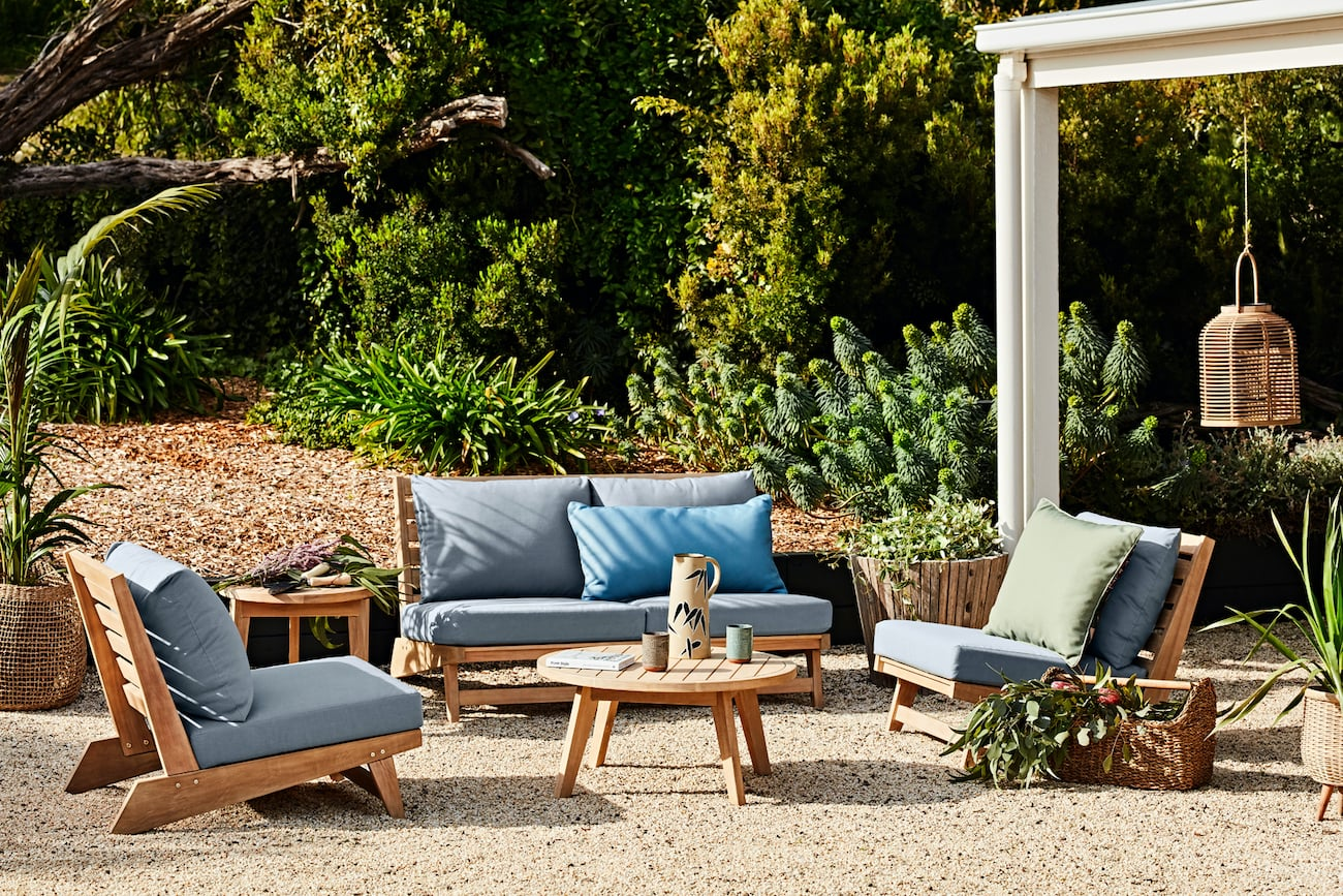 early settler outdoor furniture lounge suite timber with blue cushions and coffee table