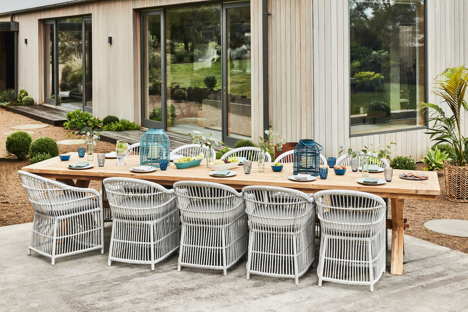 early settler extra large reclaimed tea dining table with grey wicker hamptons outdoor chairs