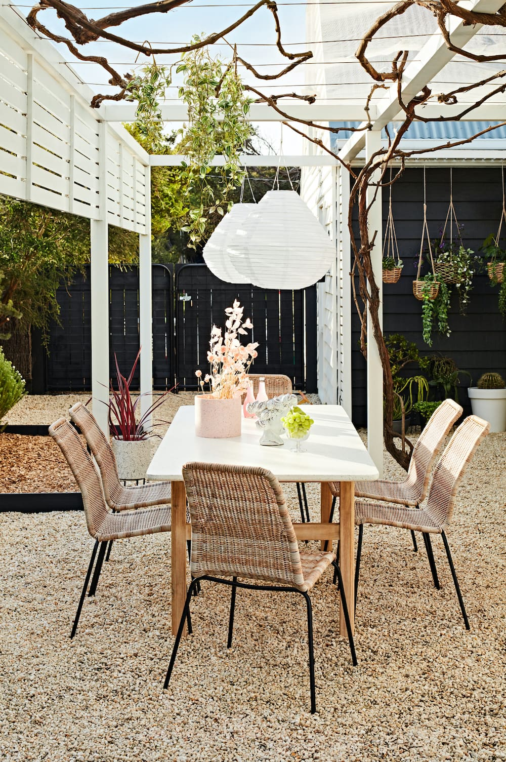 early settler outdoor furniture white marble look outdoor table and wicker dining chairs