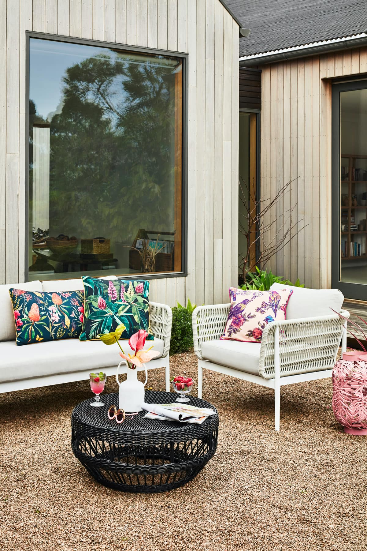 early settler white wicker outdoor lounge setting with white armchair and grey cushion