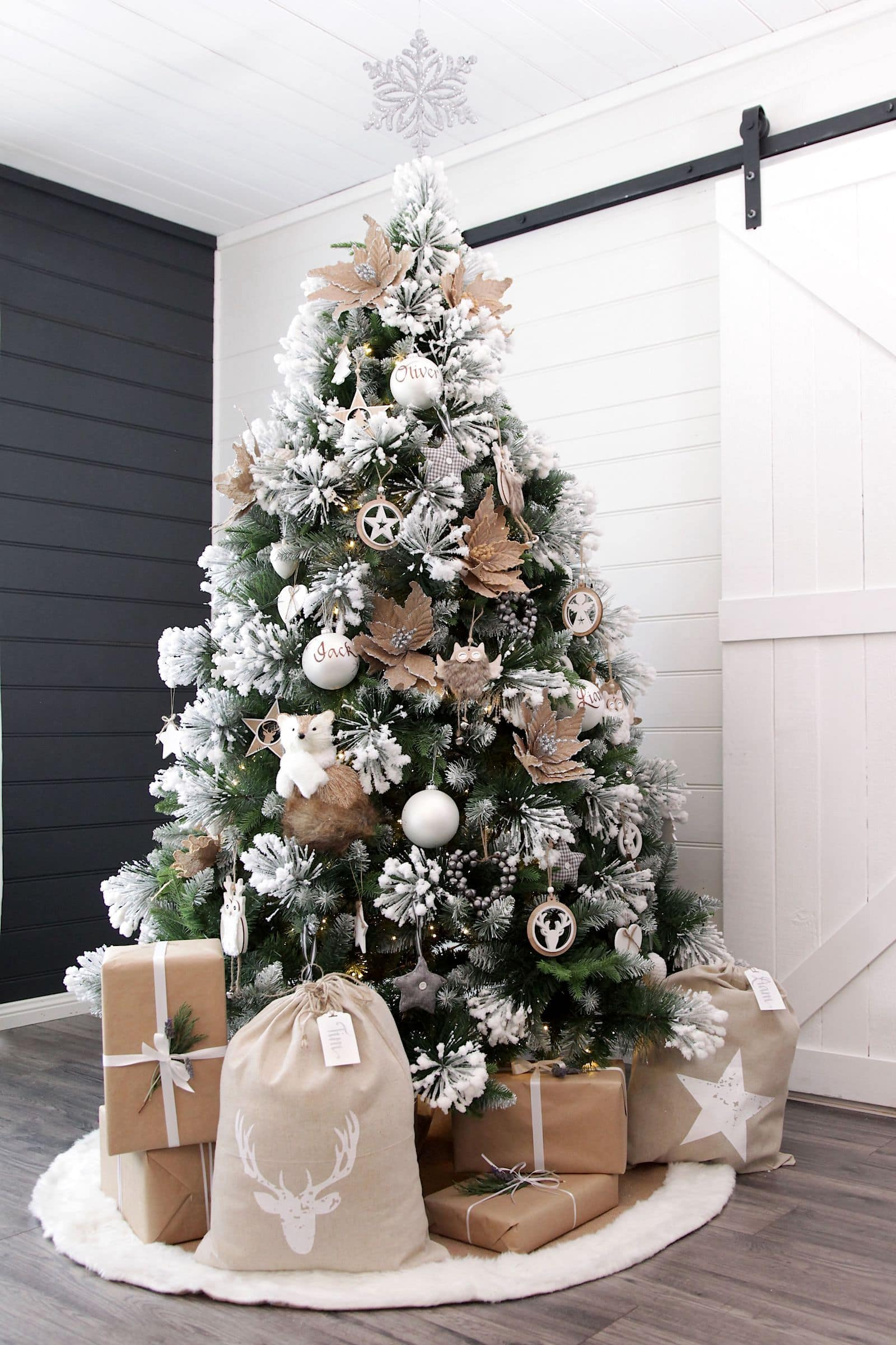 fake christmas tree with snow and white and timber tree decorations
