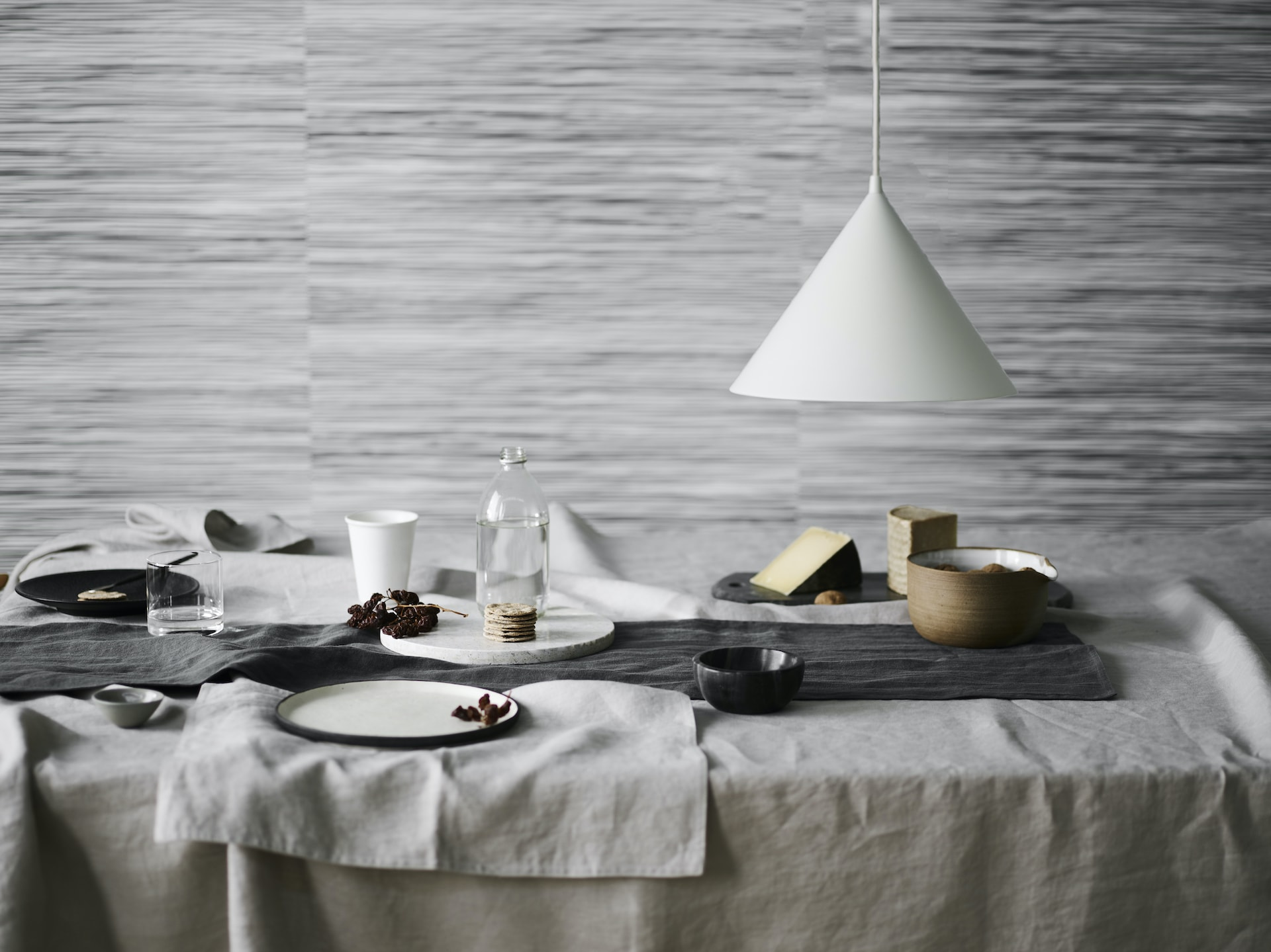 grey dining room with light gret linen tablecloth and napkins lorraine lea