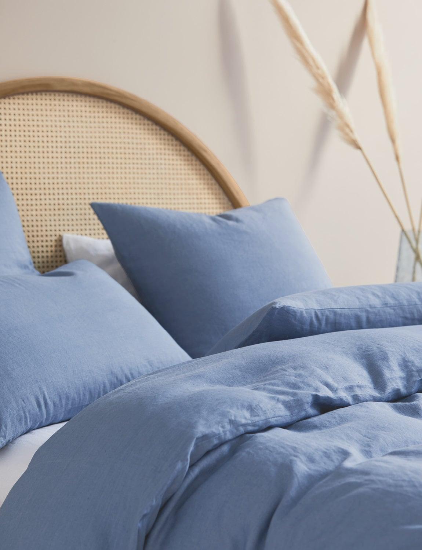 light blue quilt cover set on curved rattan headboard lorraine lea
