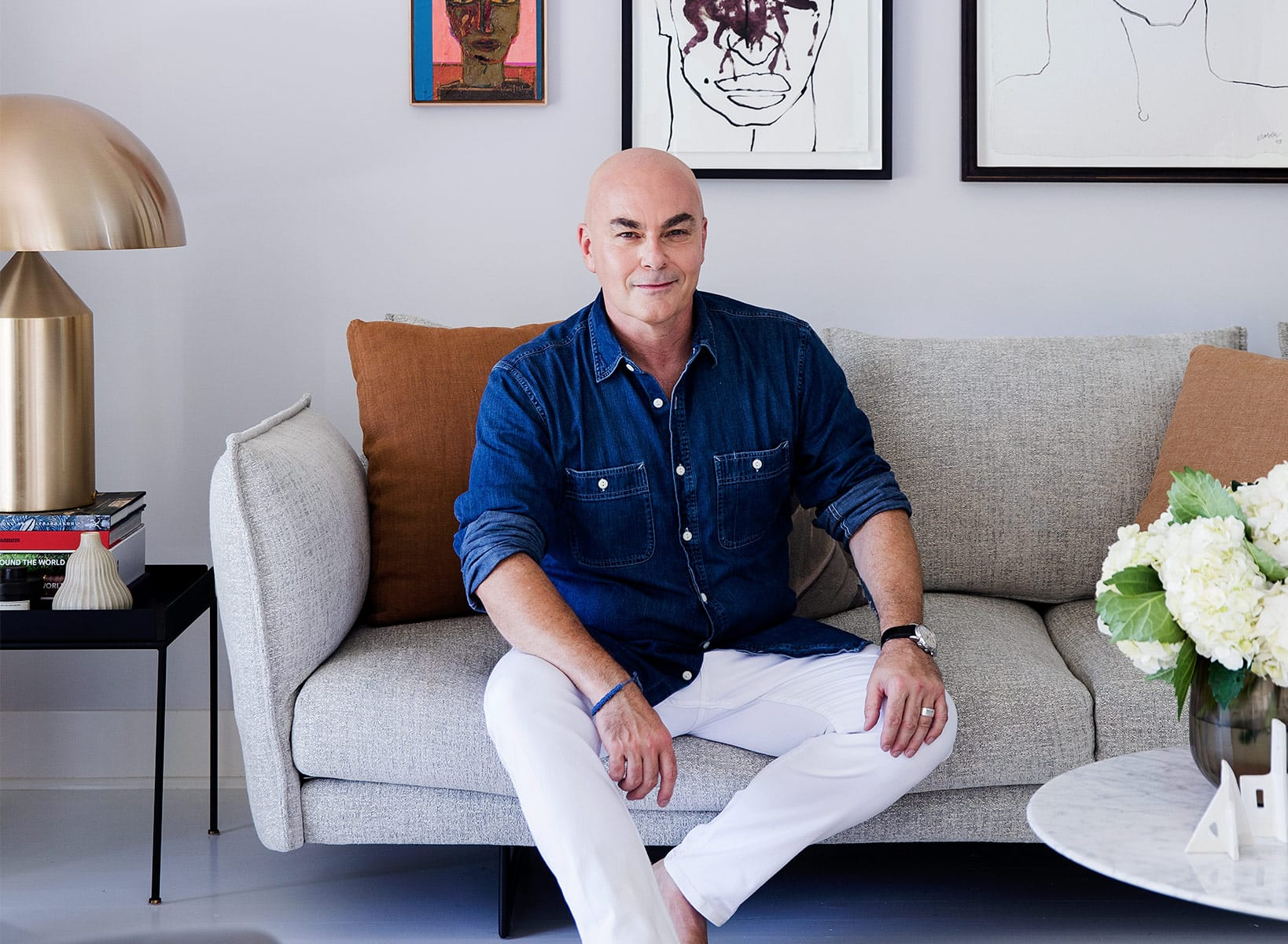 neale whitaker king living ambassador on grey sofa