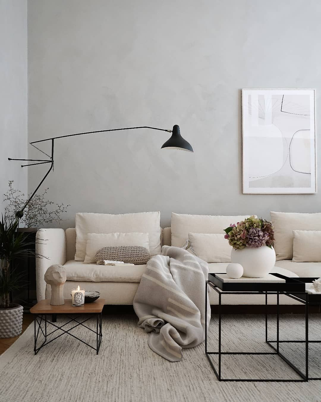 neutral living roo with cream sofa and suede paint effect on walls