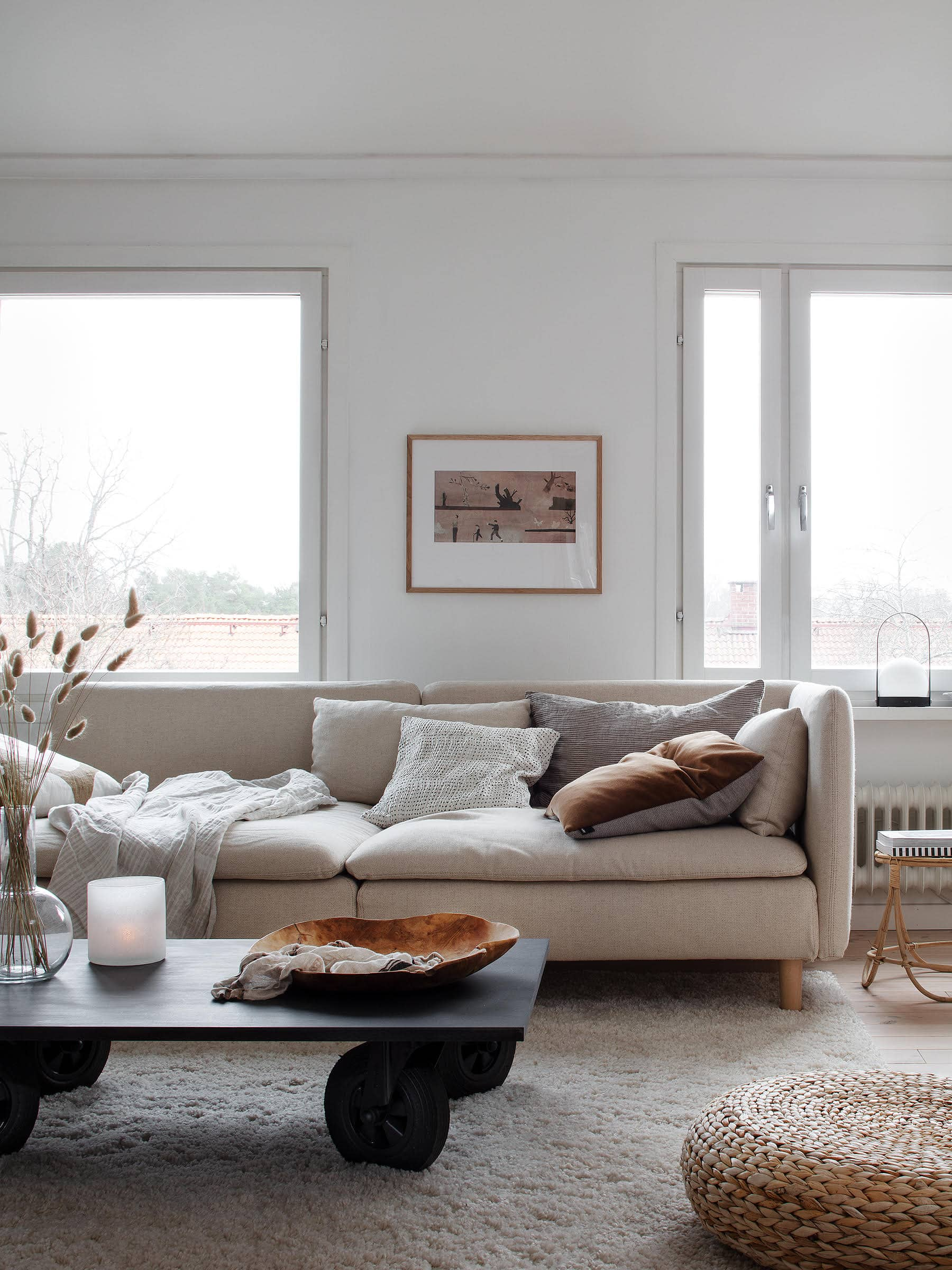 neutral living room with beige sofa and black coffee table