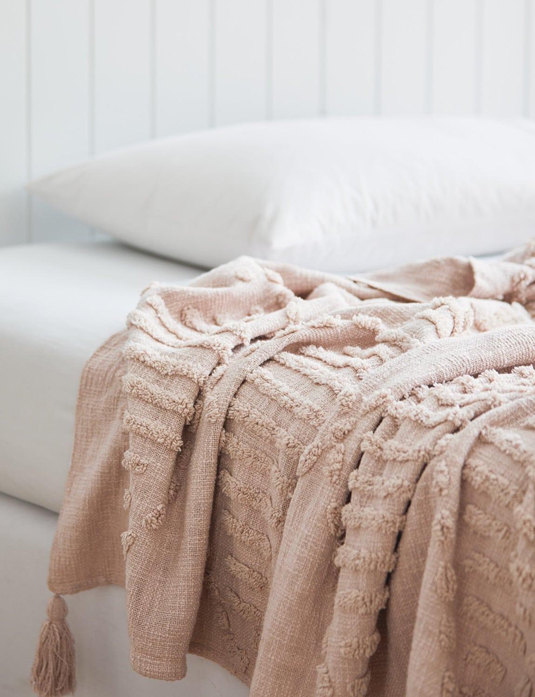 soft pink textures throw blanket on white bedding lorraine lea