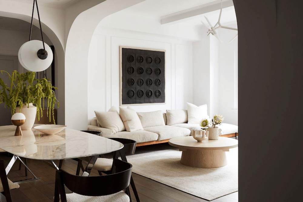 space exploration neutral luxe living room with marble dining table and round coffee table