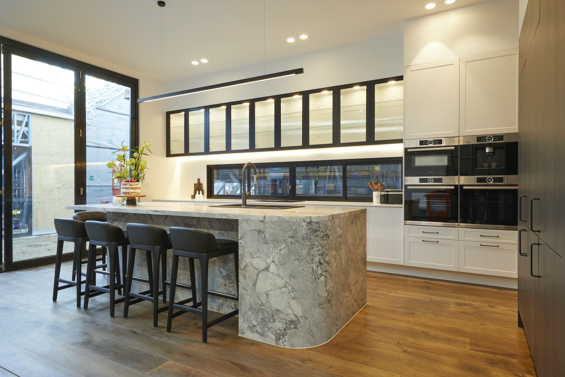 the block 2020 Sarah and George Kitchen with curved stone island bench