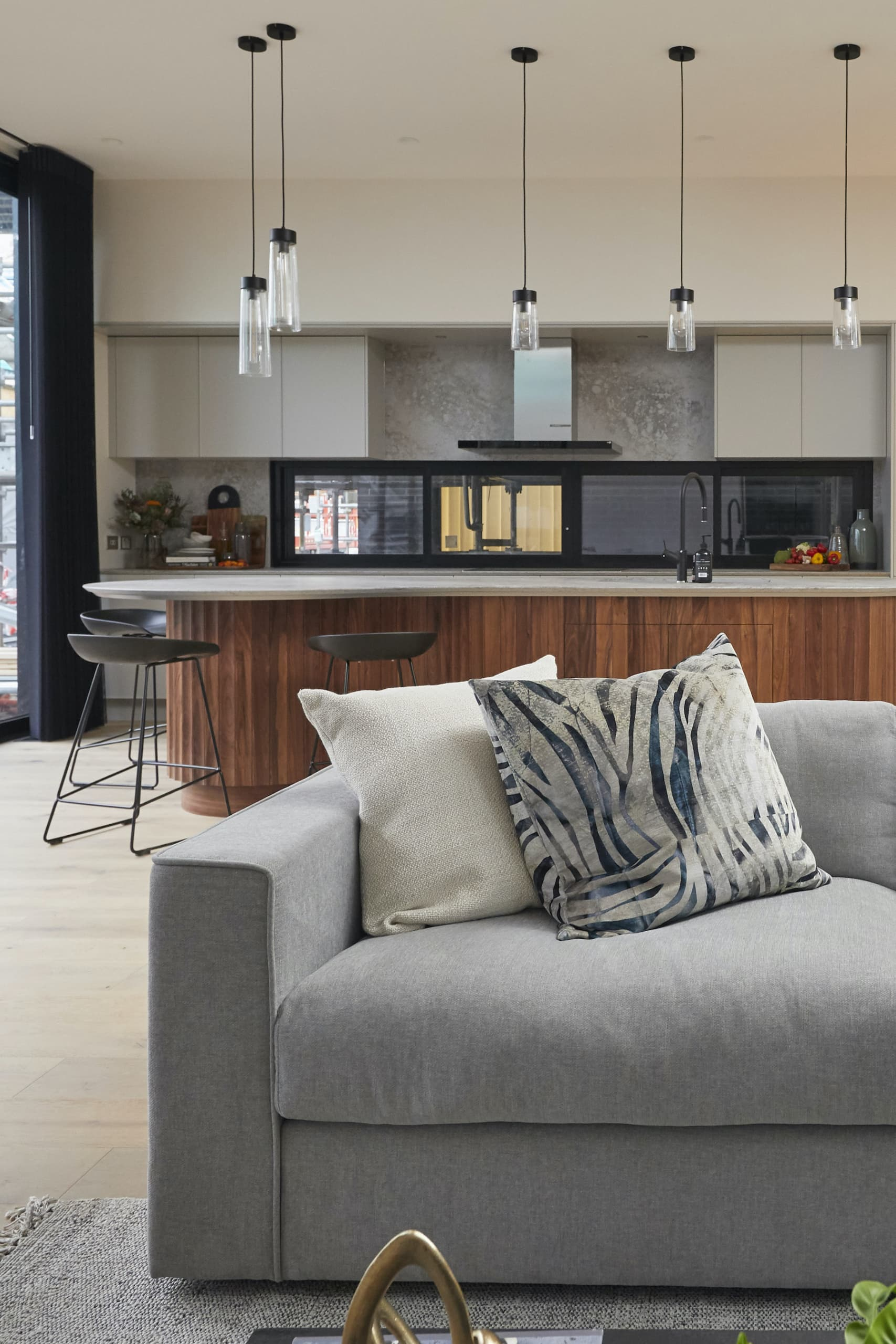 the block 2020 daniel and jade living room with grey sofa