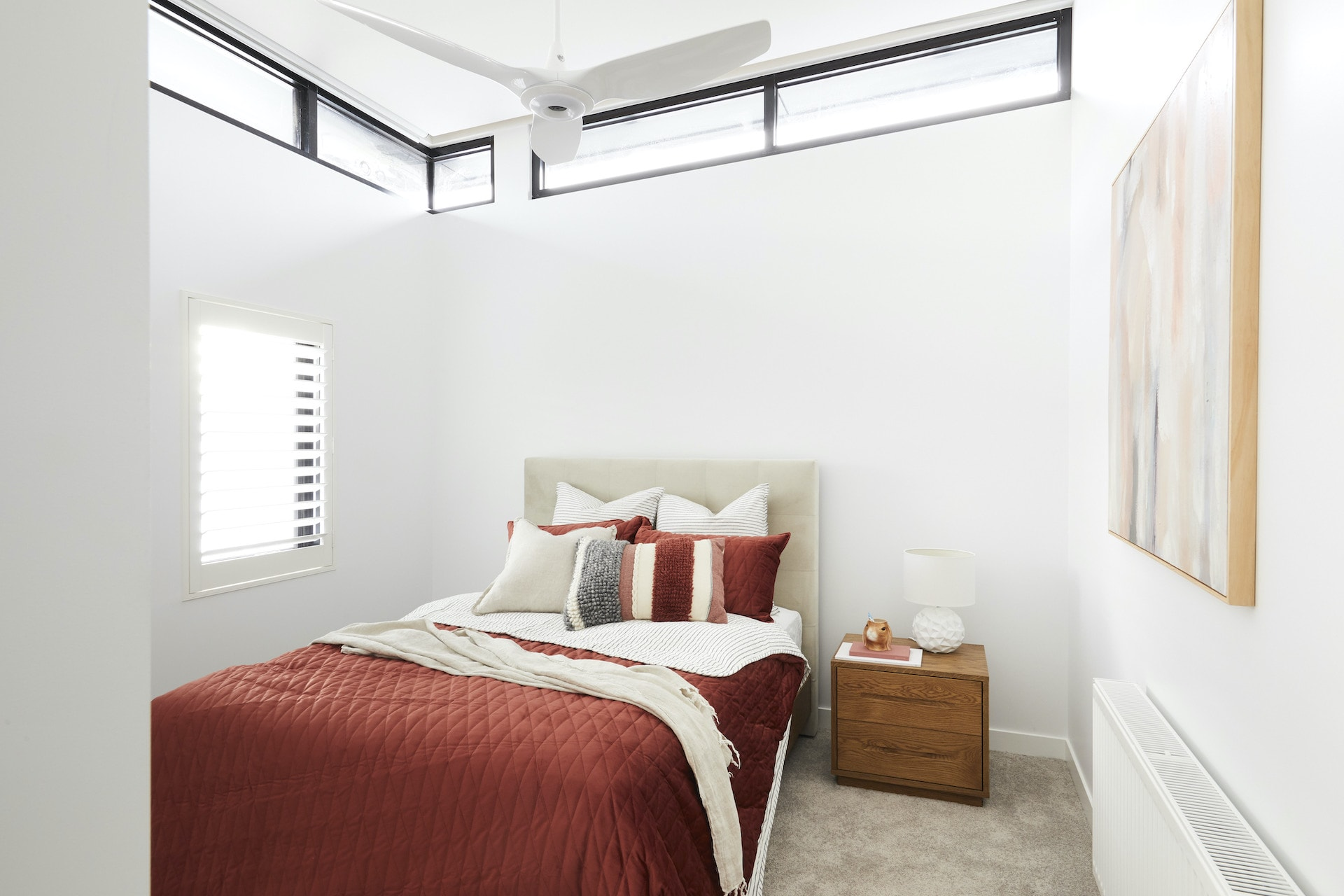 the block 2020 daniel and jade upstairs bedroom with red bedding