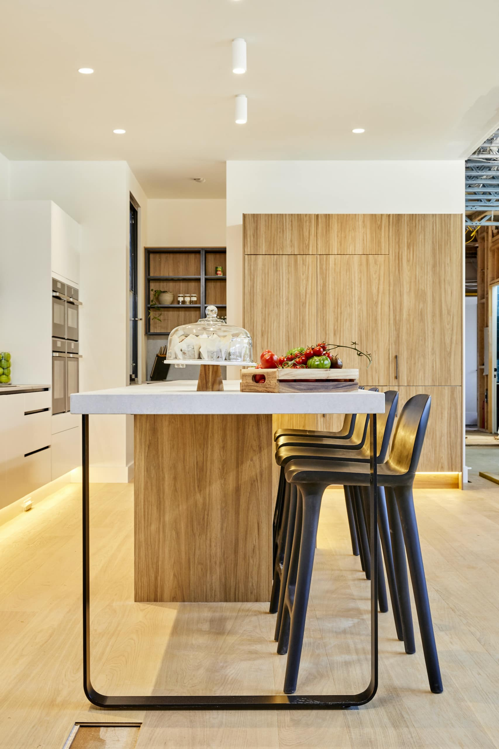 the block 2020 harry and tash kitchen with light corrugated timber cabinets and oak flooring