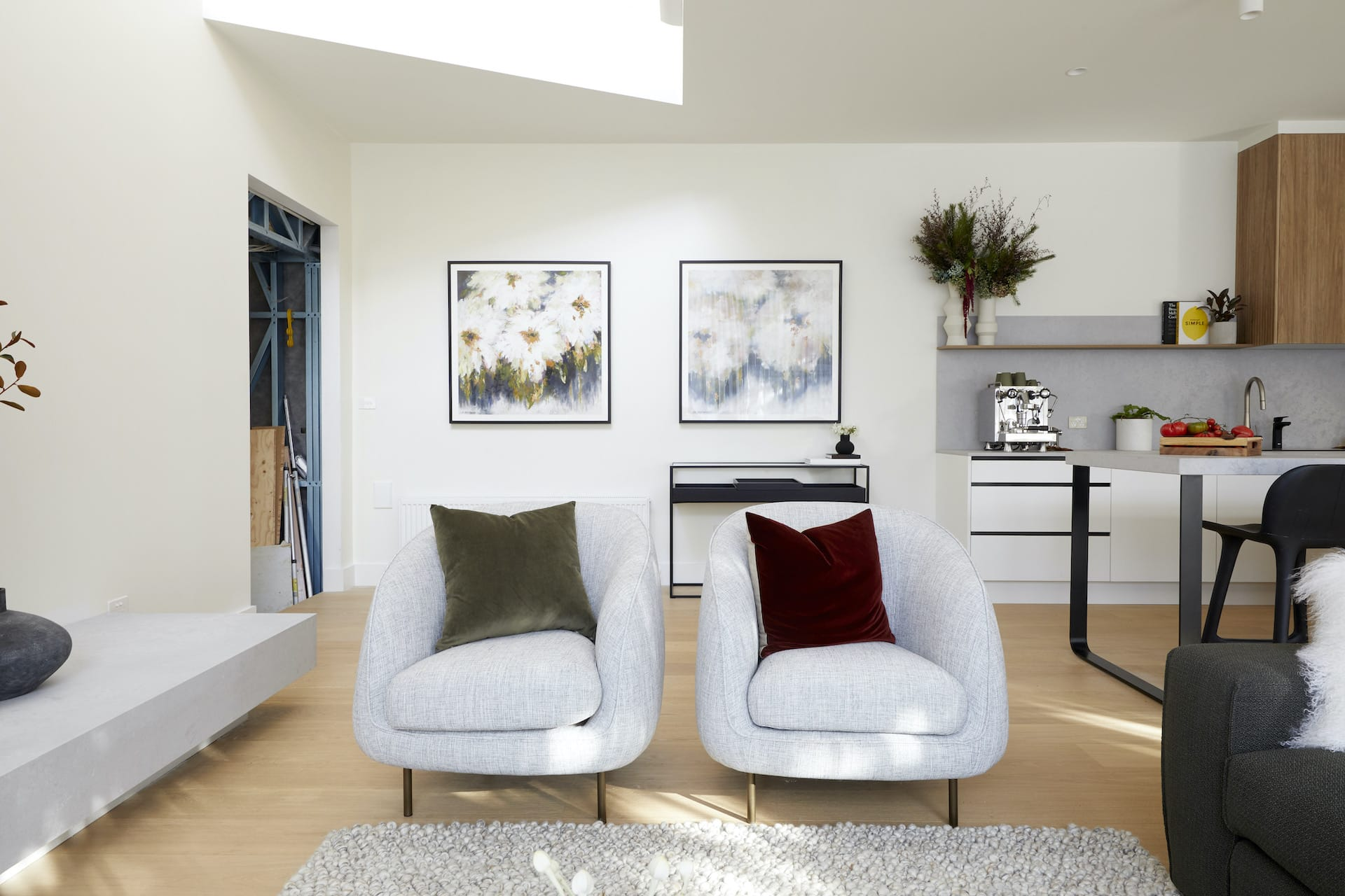 the block 2020 harry and tash living room with grey armchairs and jewel tone cushions