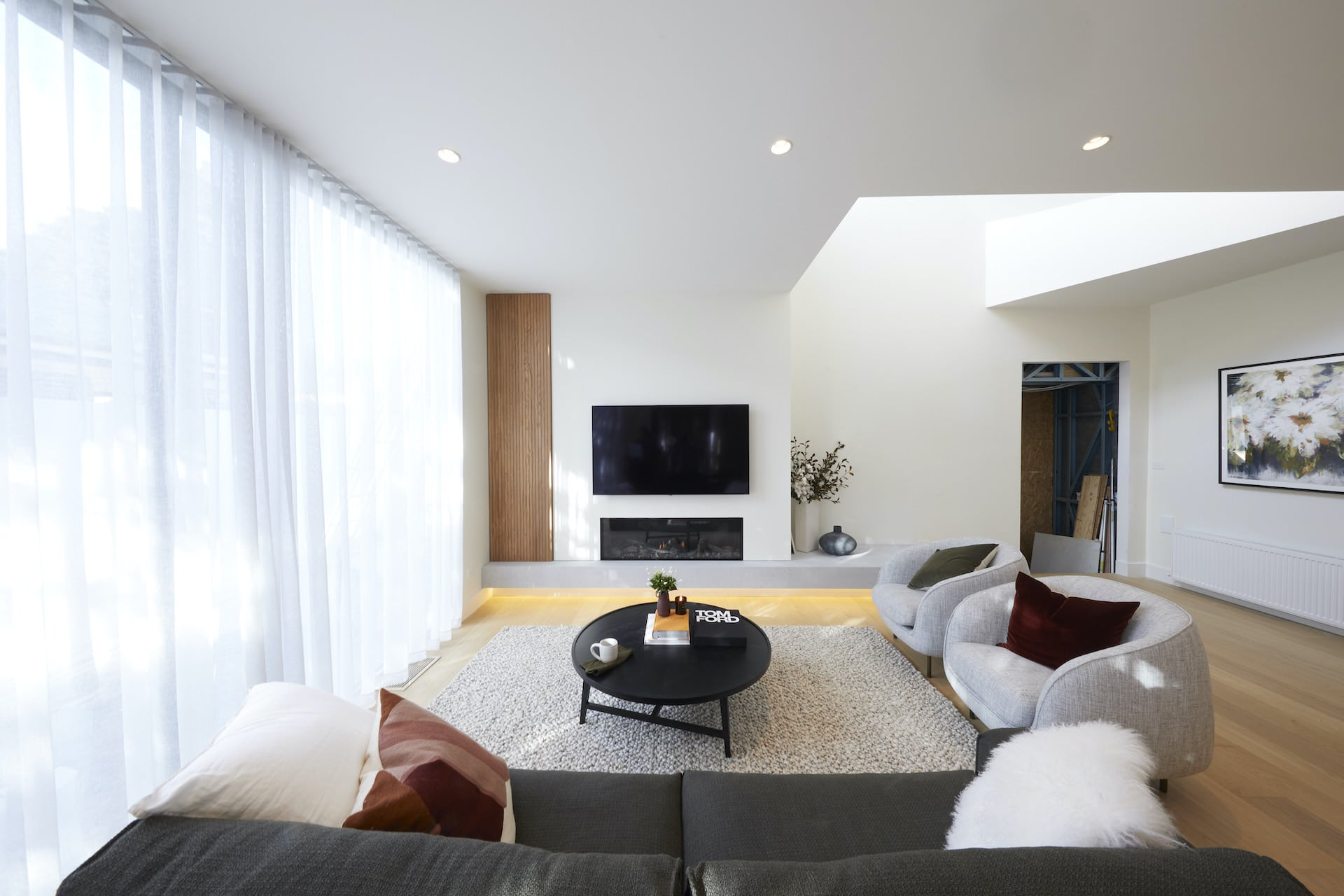 the block 2020 harry and tash living room with white sheer curtains and mounted tv
