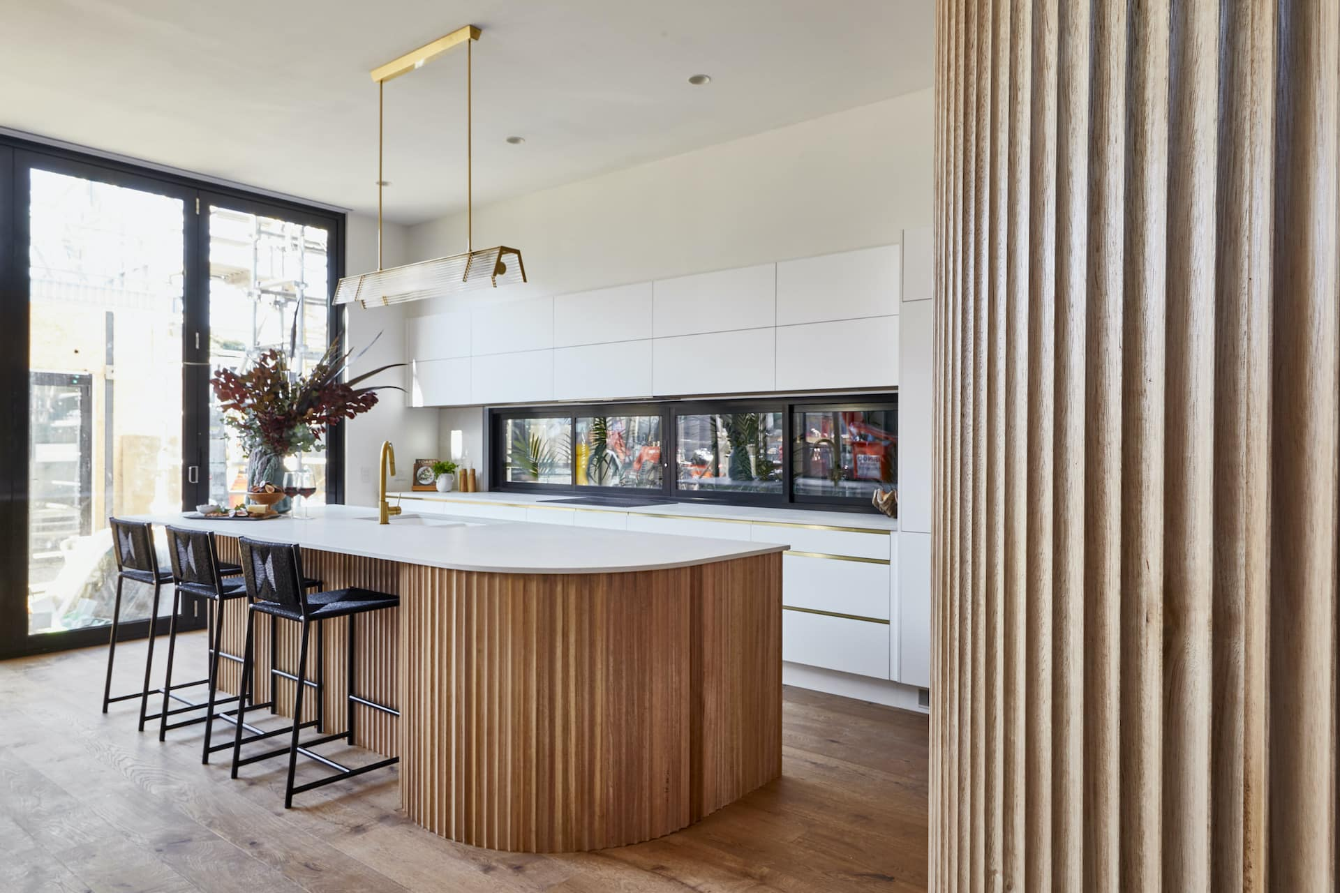 the block 2020 kitchens Luke and Jasmin Kitchen cabinets corrugated timber fronts curved wall