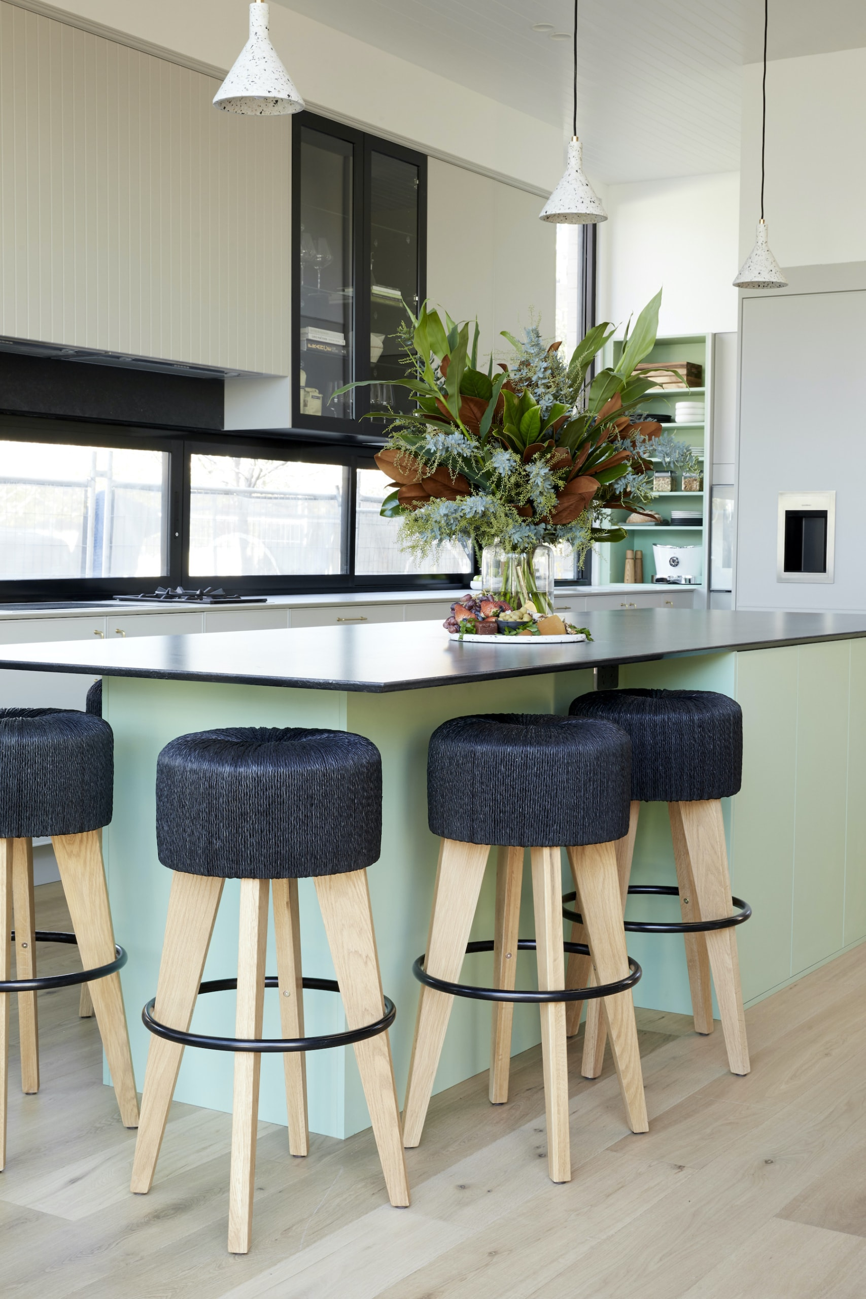 the block 2020 kitchens jimmy and tam kitchen island with black stools