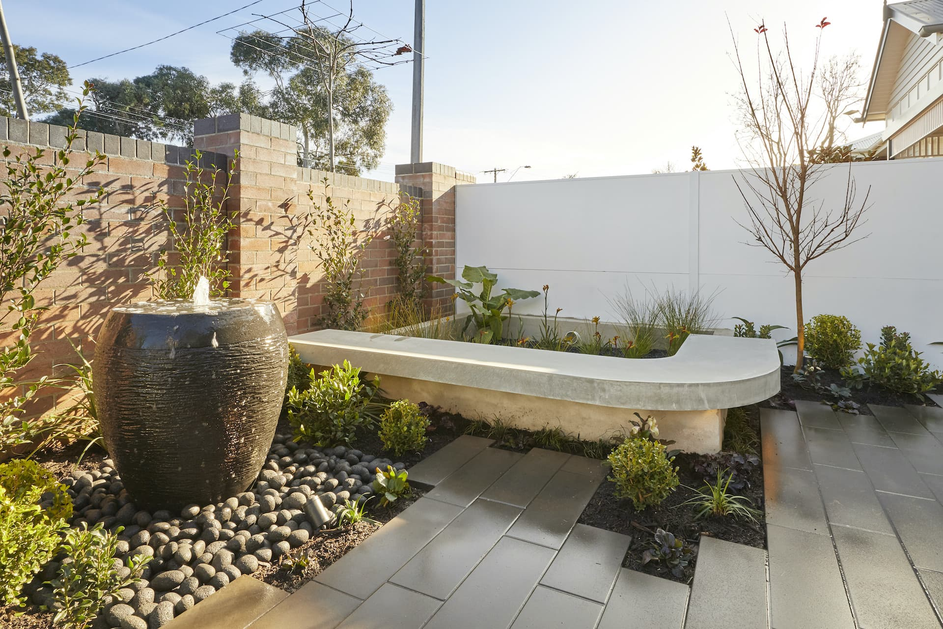 the block 2020 luke and jasmin front garden curved pit