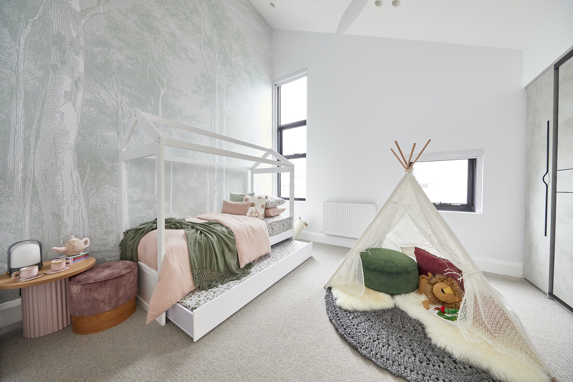 the block 2020 sarah and george upstairs kids bedroom with forest wallpaper and white house bed