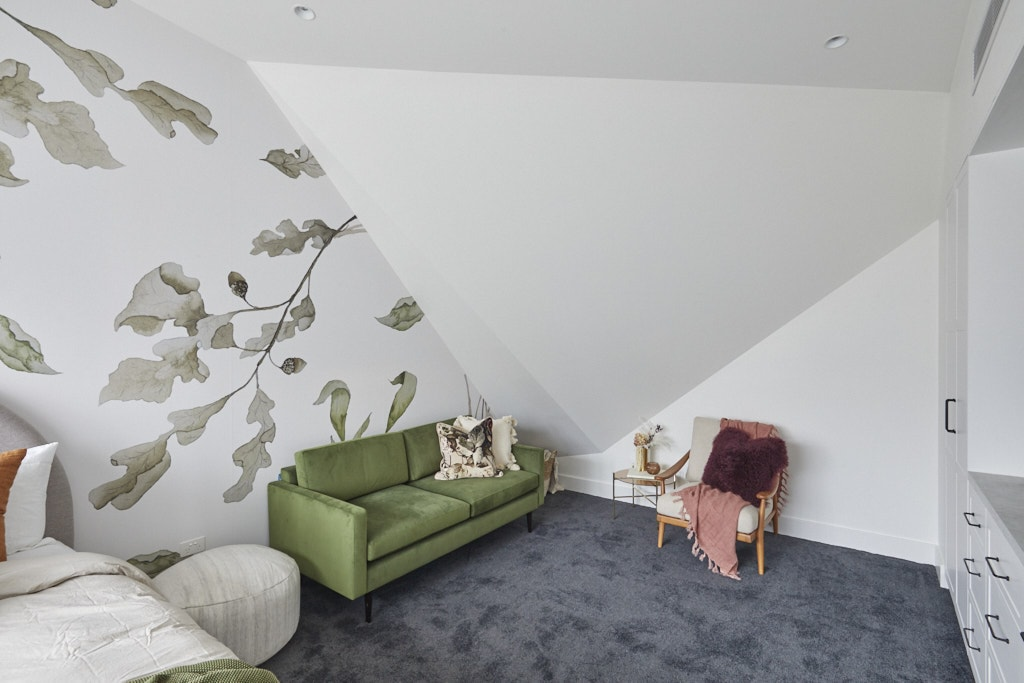 the block 2020 upstairs bedroom with leaf wallpaper and green sofa