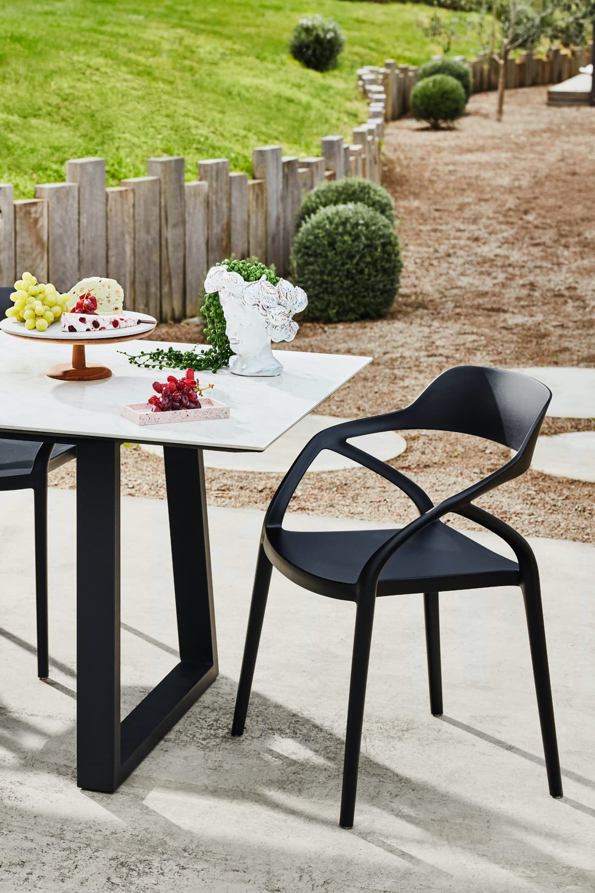 white ceramic top outdoor table with black metal legs early settler