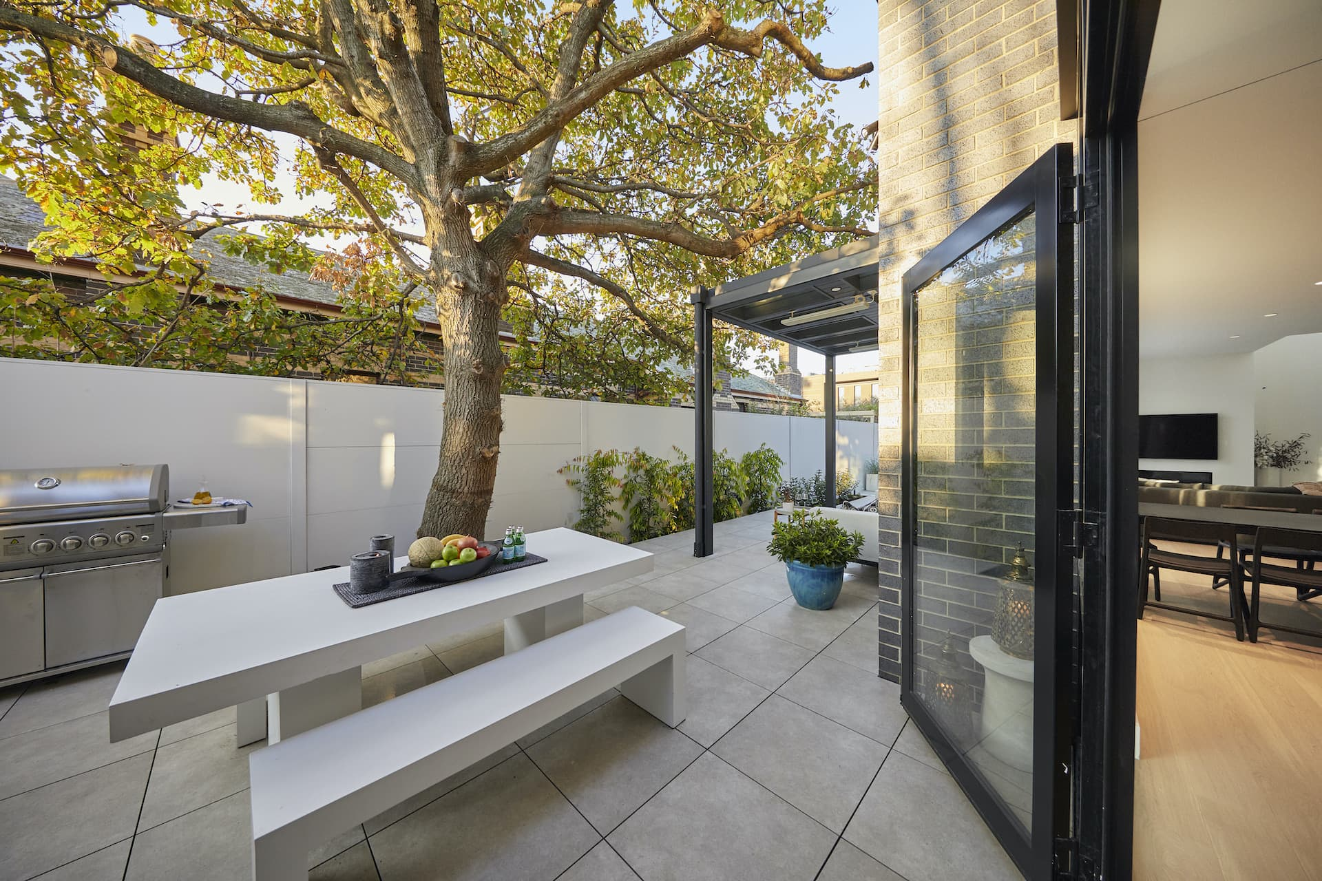 the block 2020 harry and tash backyard side paved area