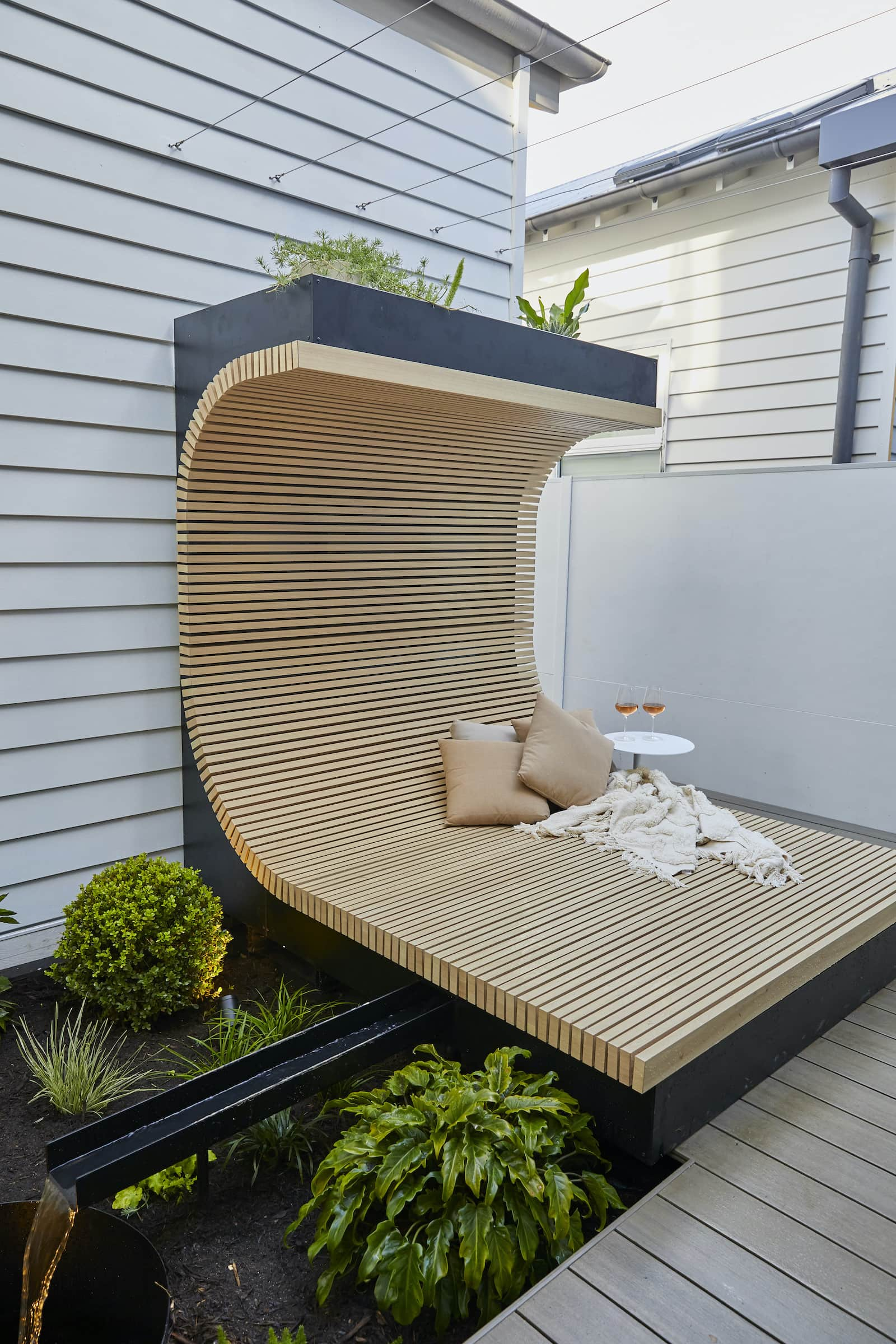 the block 2020 luke and jasmin curved daybed in backyard