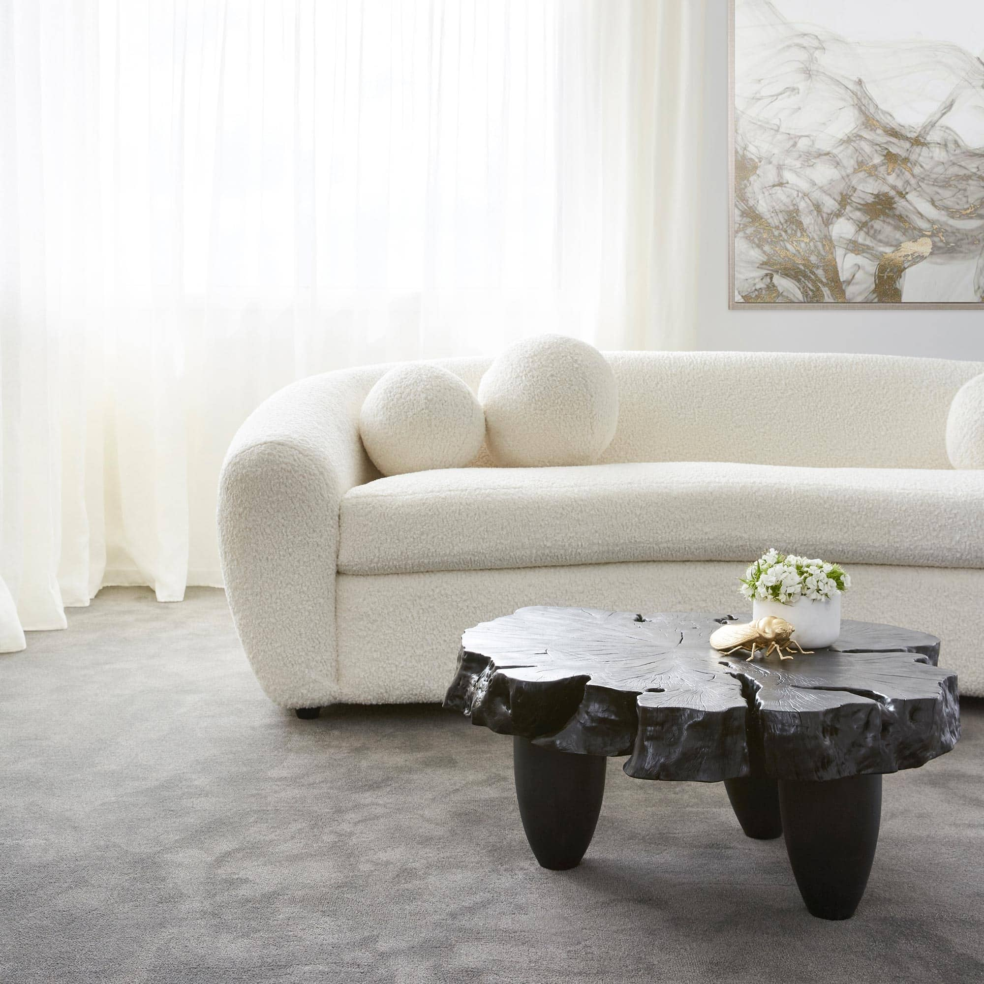 black organic coffee table coco republic white boucle sofa luxe living room