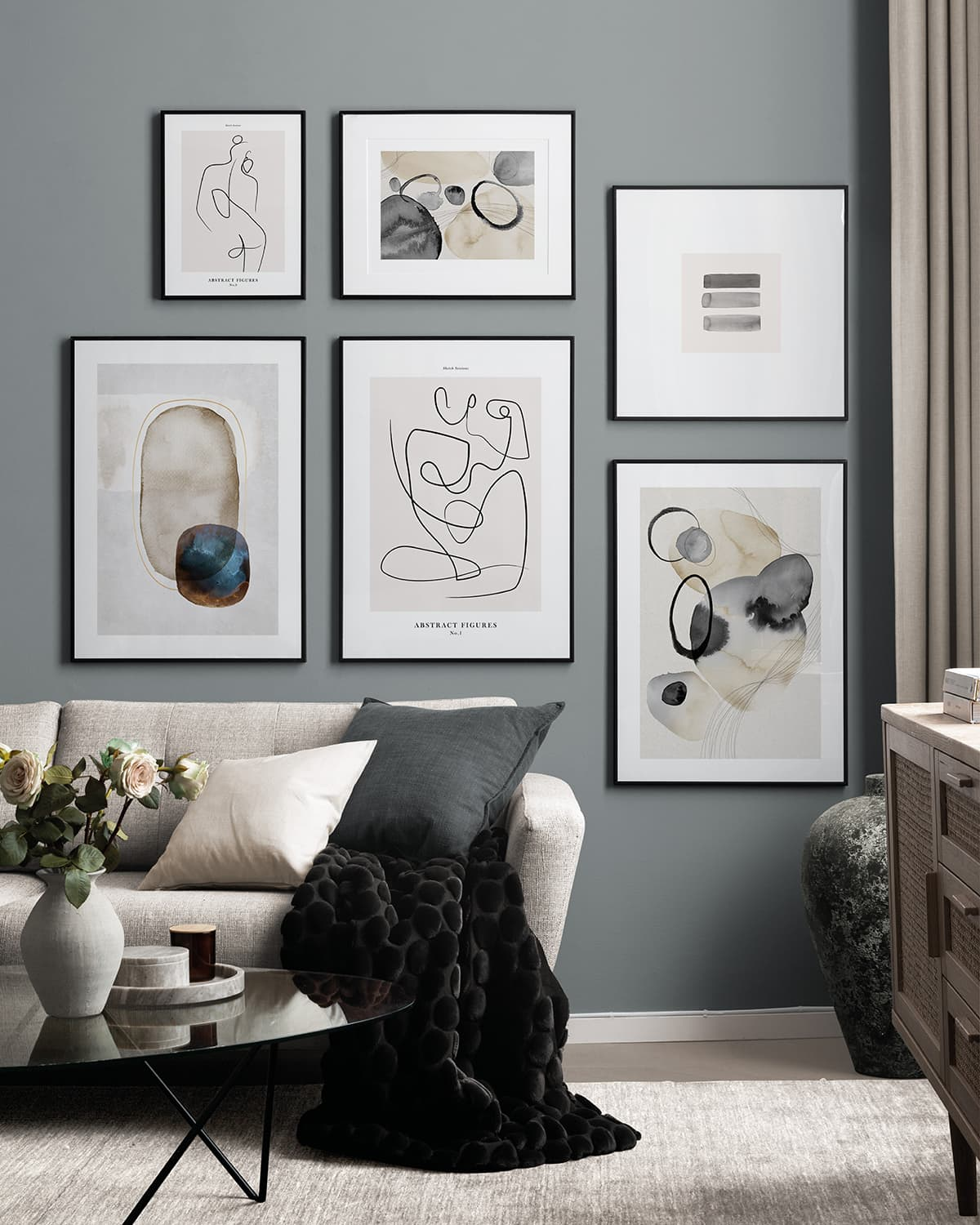 black white and grey gallery wall artworks in living room desenio prints framed on wall