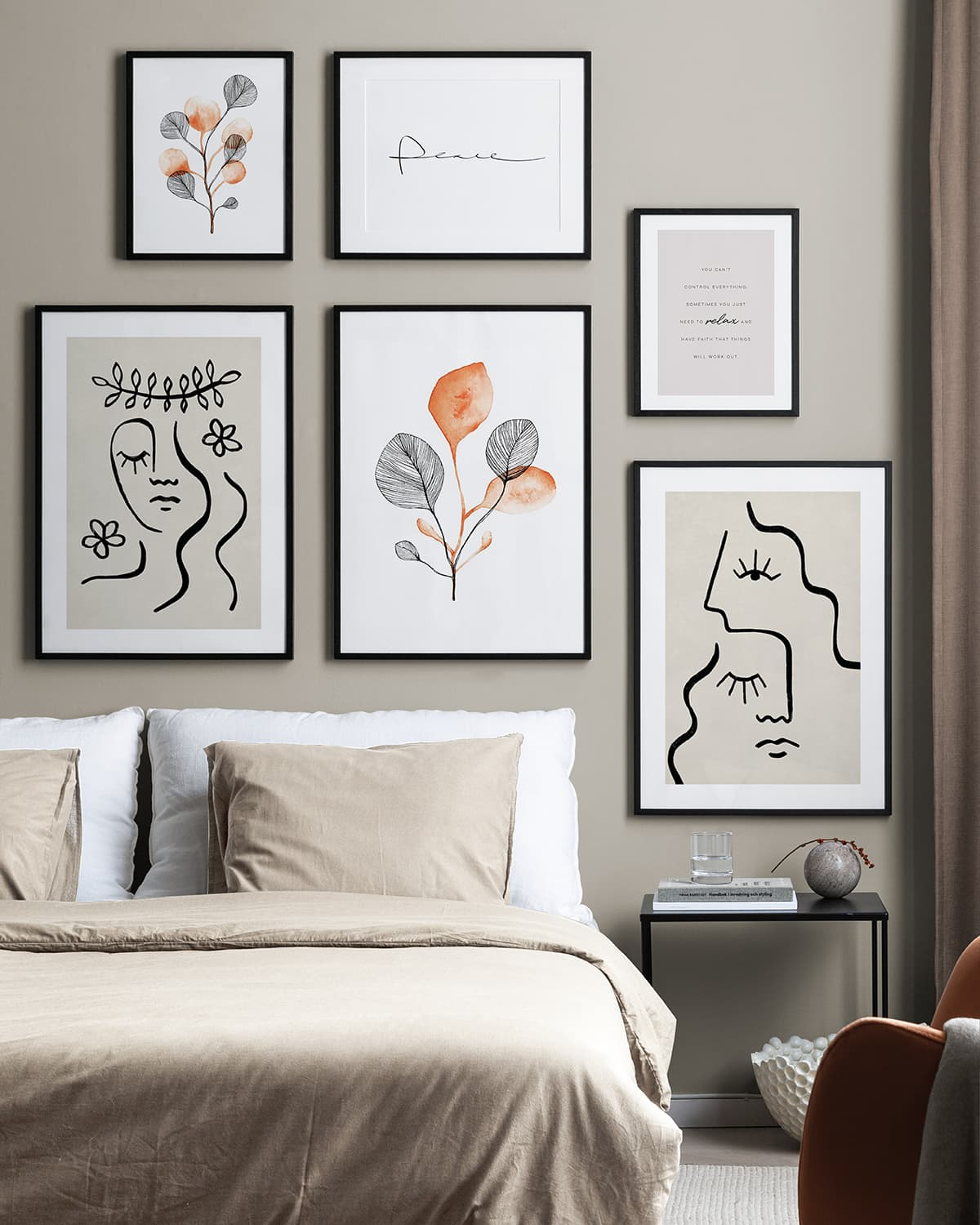 creating a gallery wall in a bedroom black and white artworks on bedroom wall