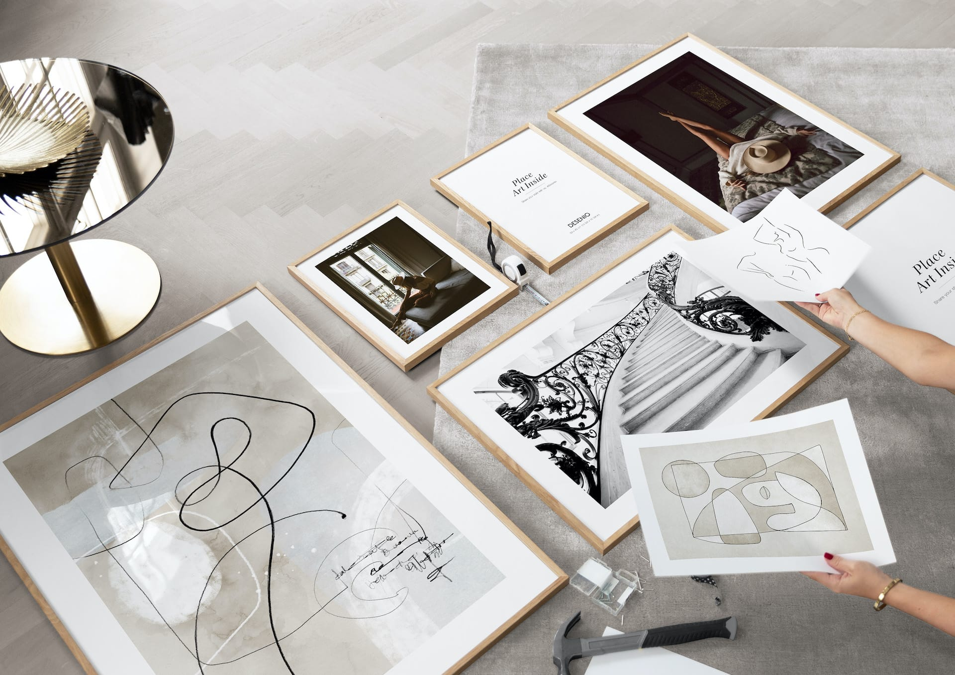 creating a gallery wall with oak frames and desenio art