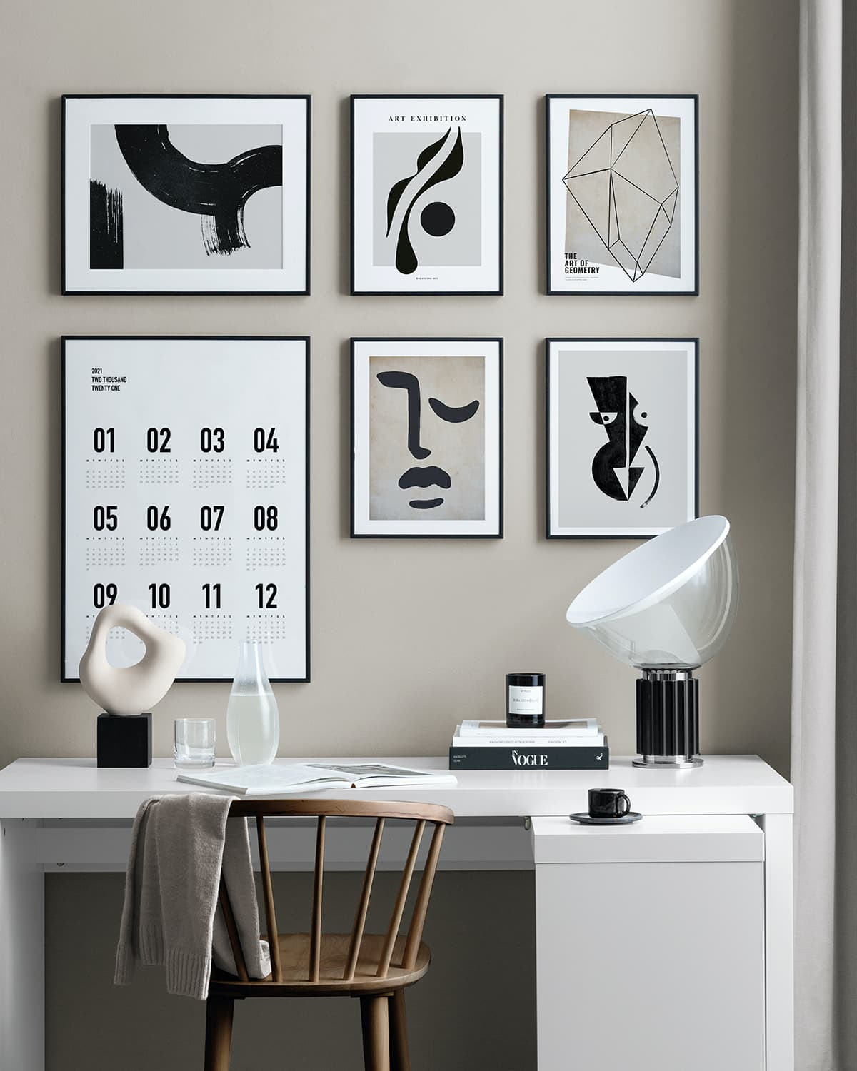 desenio art black and white gallery wall on beige painted wall in home office